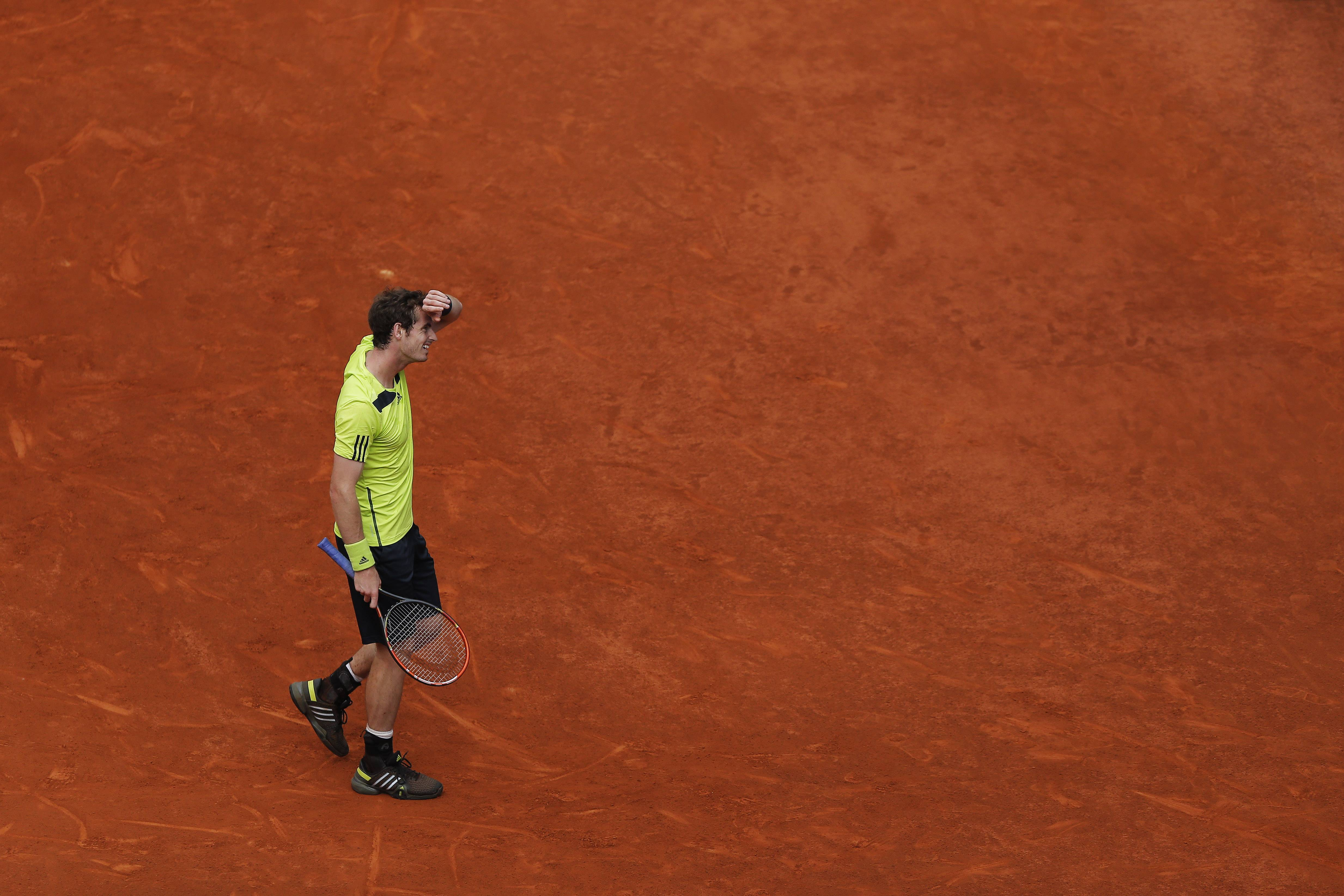 Andy Murray from Britain reacts during a Madrid Open tennis tournament match against Santiago Giraldo from Colombia in Madrid, Spain, Thursday, May 8, 2014.