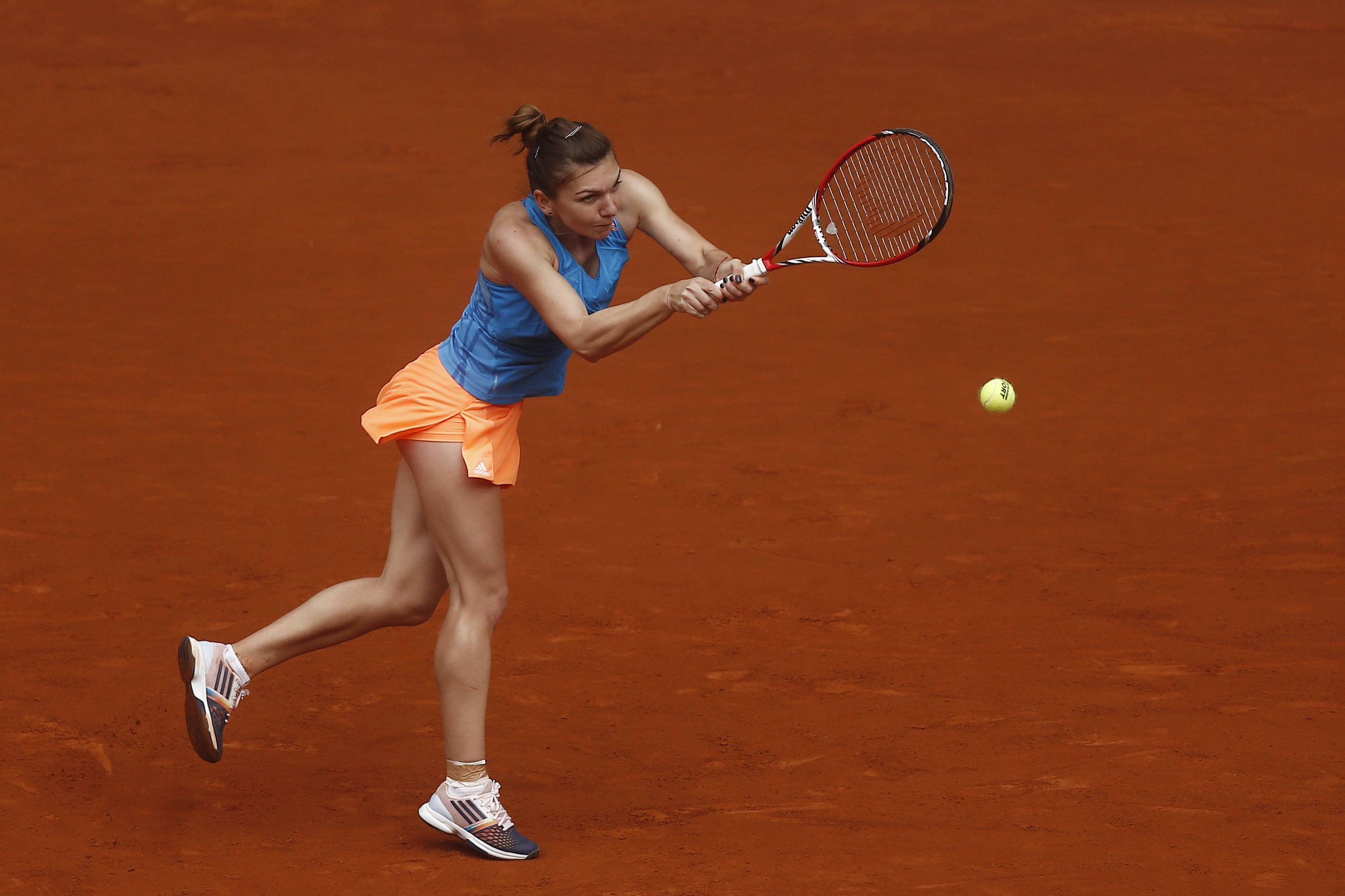 Simona Halep from Romania returns the ball to Lara Arruabarrena from Spain during a Madrid Open tennis tournament match in Madrid, Spain, Wednesday May 7, 2014.