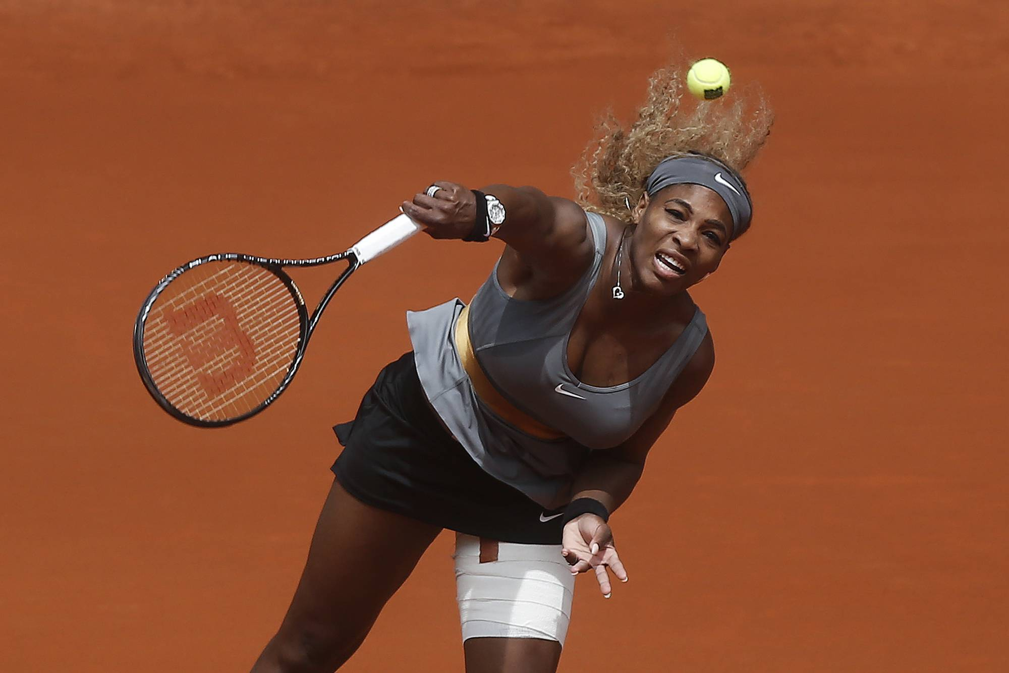 Serena Williams from U.S. serves during a Madrid Open tennis tournament match against Shuai Peng from China, in Madrid, Spain, Wednesday, May 7, 2014.