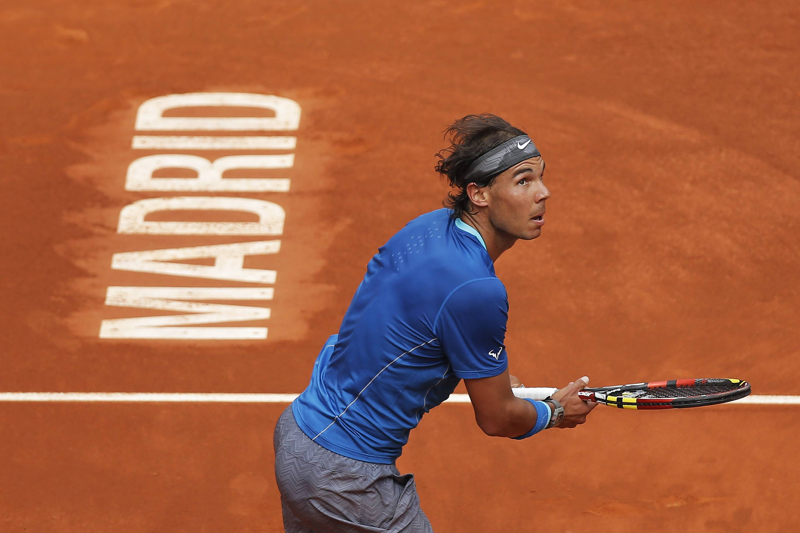 Rafael Nadal from Spain runs after the ball during a Madrid Open tennis tournament match against Juan Monaco from Argentina, in Madrid, Spain, Wednesday, May 7, 2014.