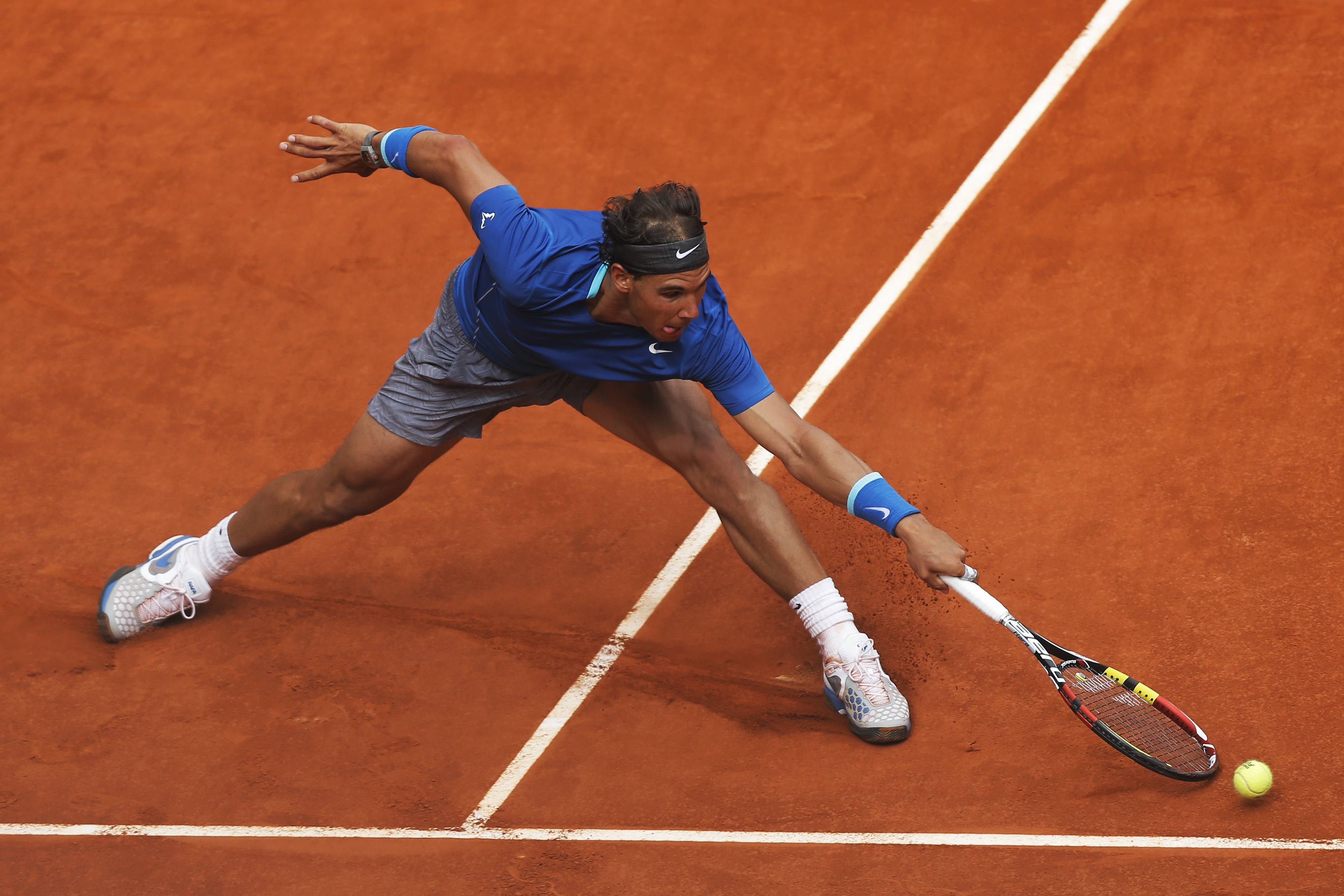 Rafael Nadal from Spain attempts to return the ball during a Madrid Open tennis tournament match against Juan Monaco from Argentina, in Madrid, Spain, Wednesday, May 7, 2014.