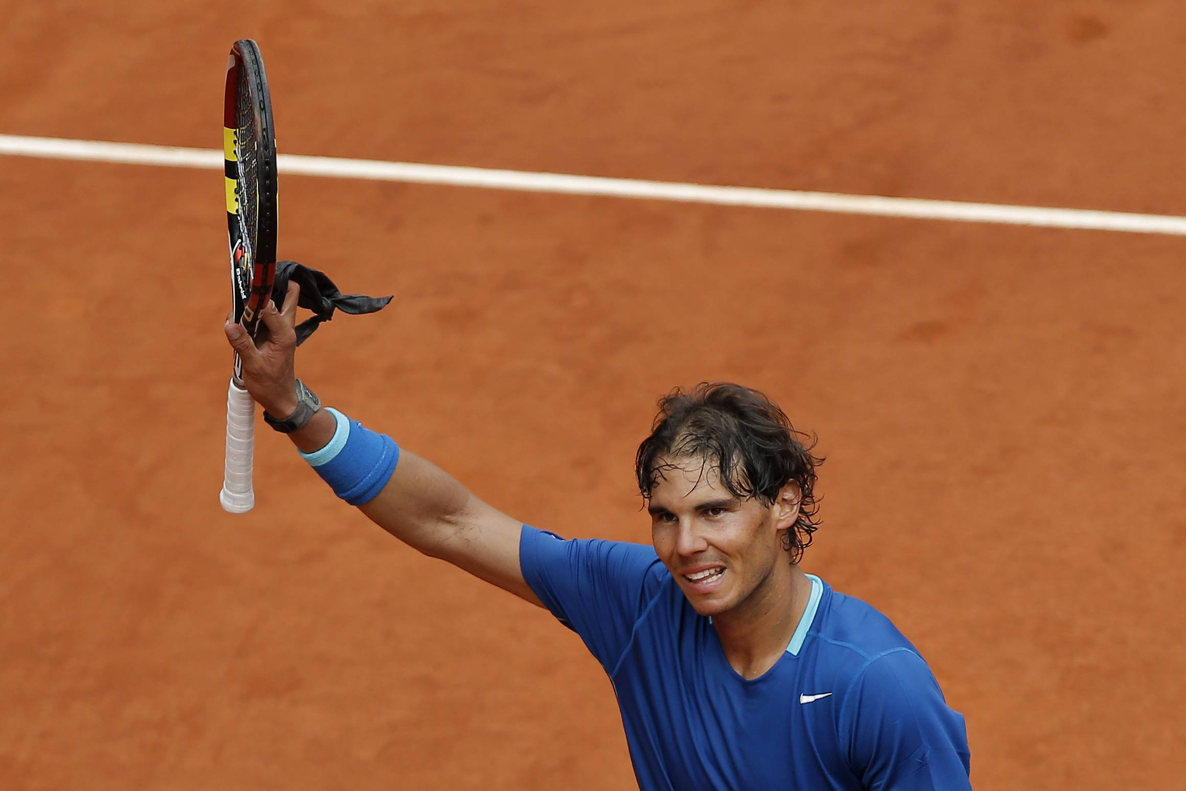 Rafael Nadal from Spain celebrates his victory during a Madrid Open tennis tournament match against Juan Monaco from Argentina, in Madrid, Spain, Wednesday, May 7, 2014.