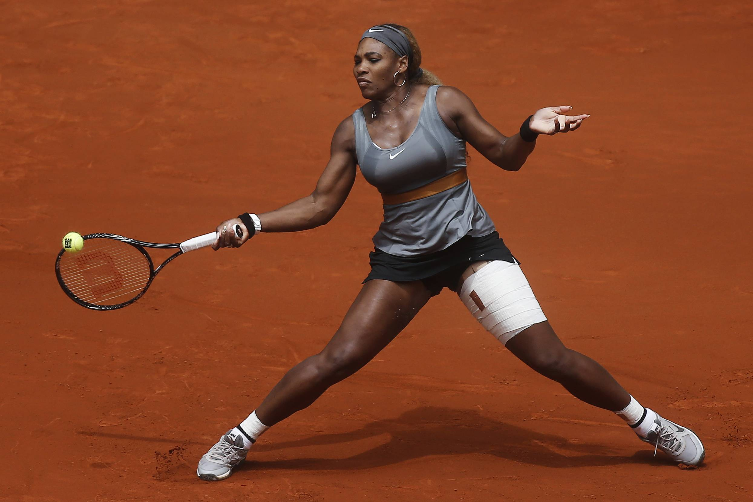 Serena Williams from the U.S. returns the ball during a Madrid Open tennis tournament match against Shuai Peng from China, in Madrid, Spain, Wednesday, May 7, 2014.