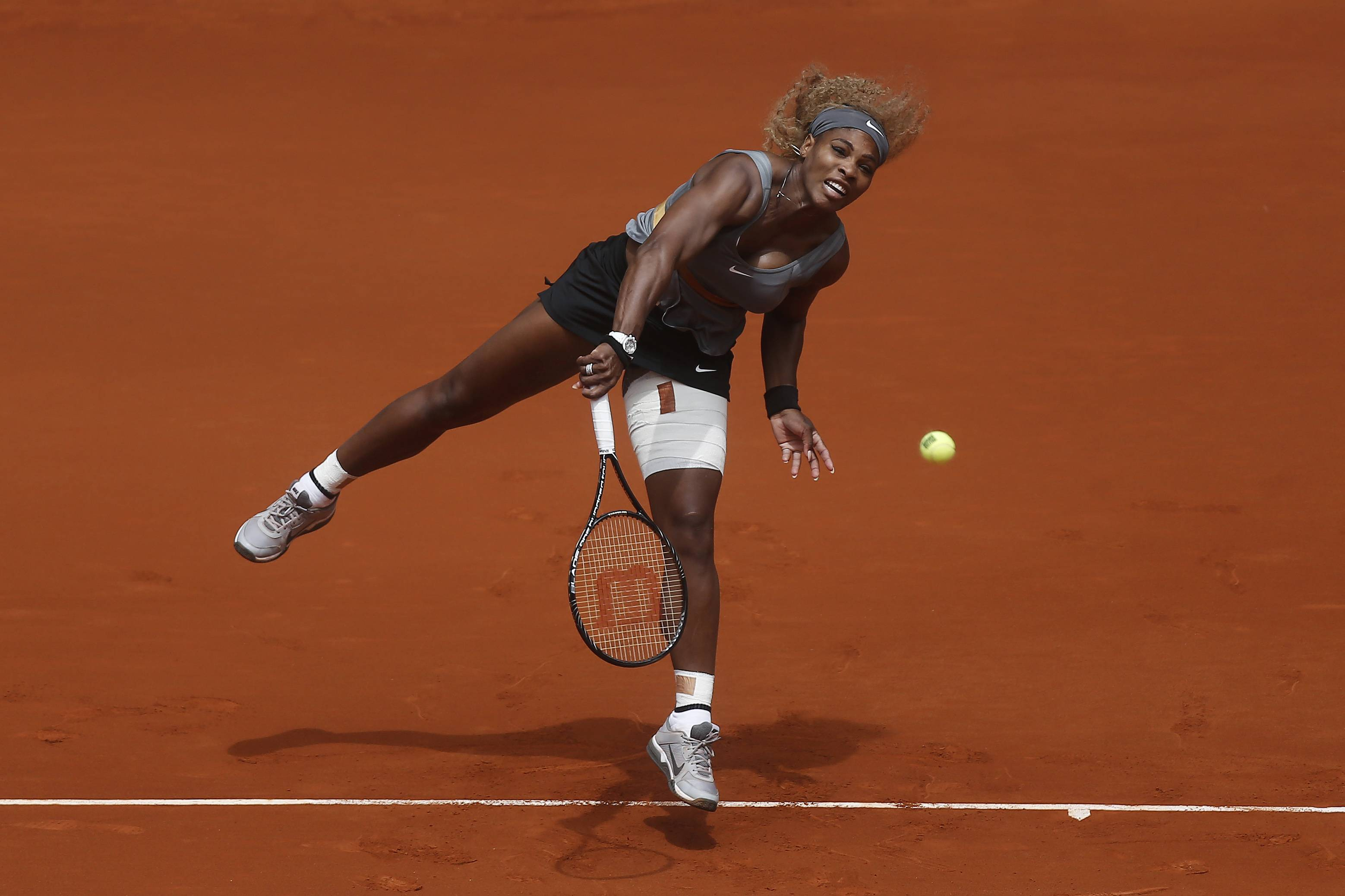 Serena Williams from the U.S. serves during a Madrid Open tennis tournament match against Shuai Peng from China, in Madrid, Spain, Wednesday, May 7, 2014.