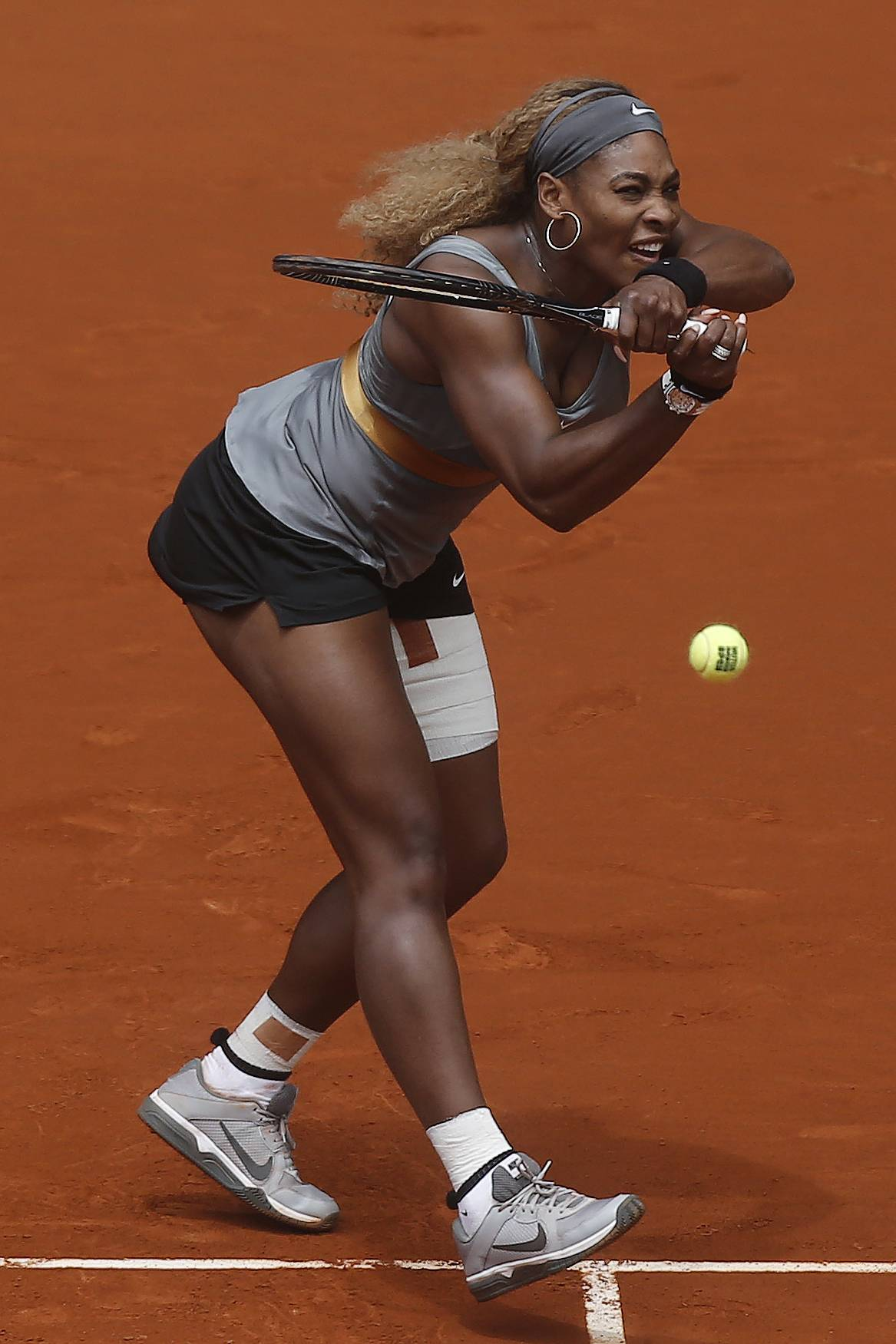 Serena Williams from U.S. returns the ball to Shuai Peng from China during a Madrid Open tennis tournament match, in Madrid, Spain, Wednesday May 7, 2014.