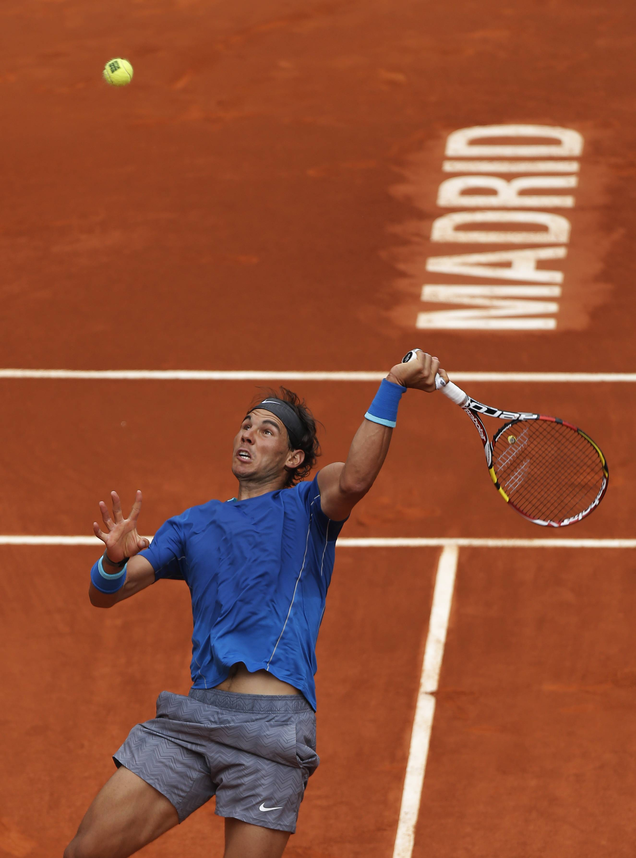 Rafael Nadal from Spain returns the ball during a Madrid Open tennis tournament match against Juan Monaco from Argentina, in Madrid, Spain, Wednesday May 7, 2014.