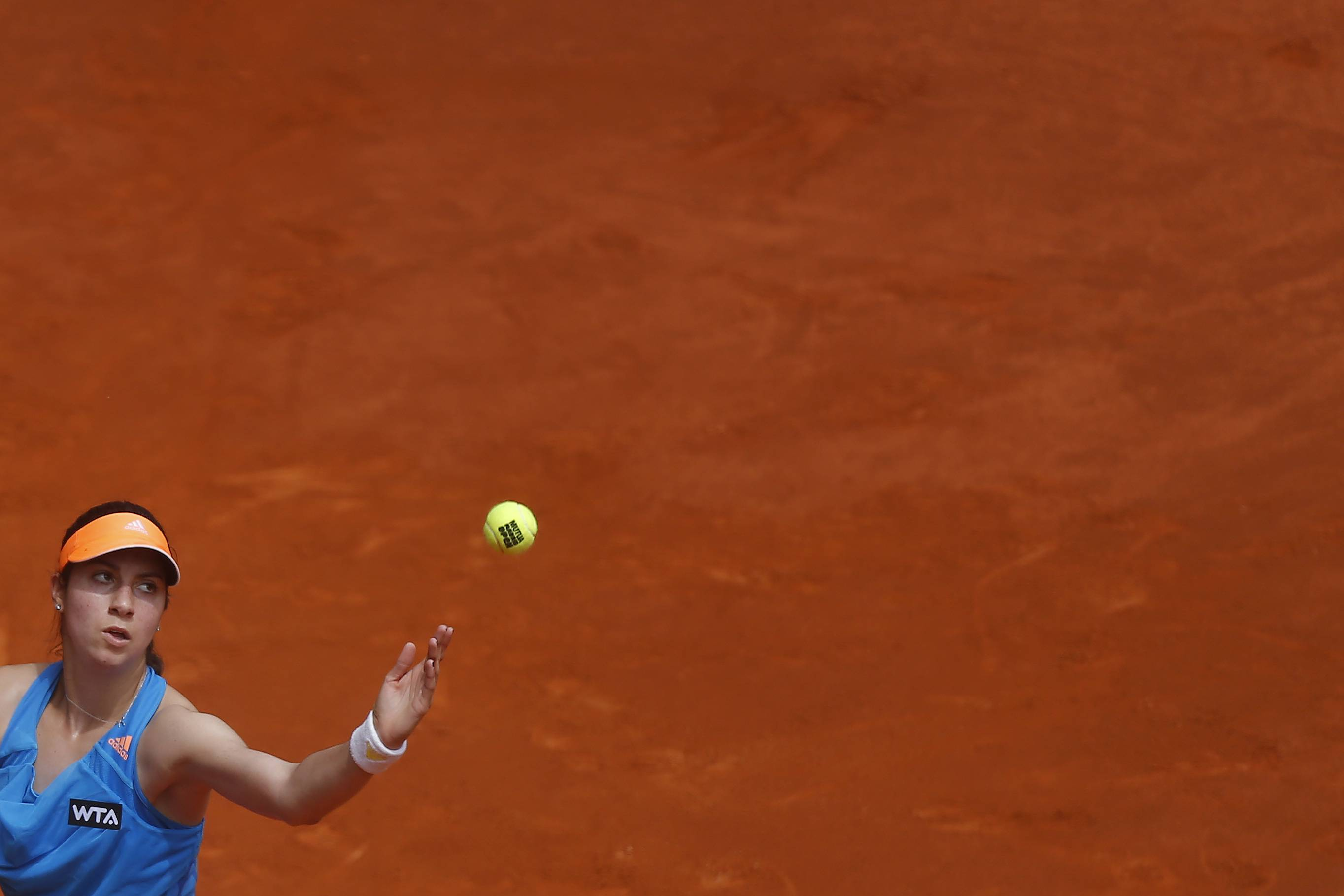 Christina McHale from U.S. serves during a Madrid Open tennis tournament match against Maria Sharapova from Russia, in Madrid, Spain, Tuesday, May 6, 2014.