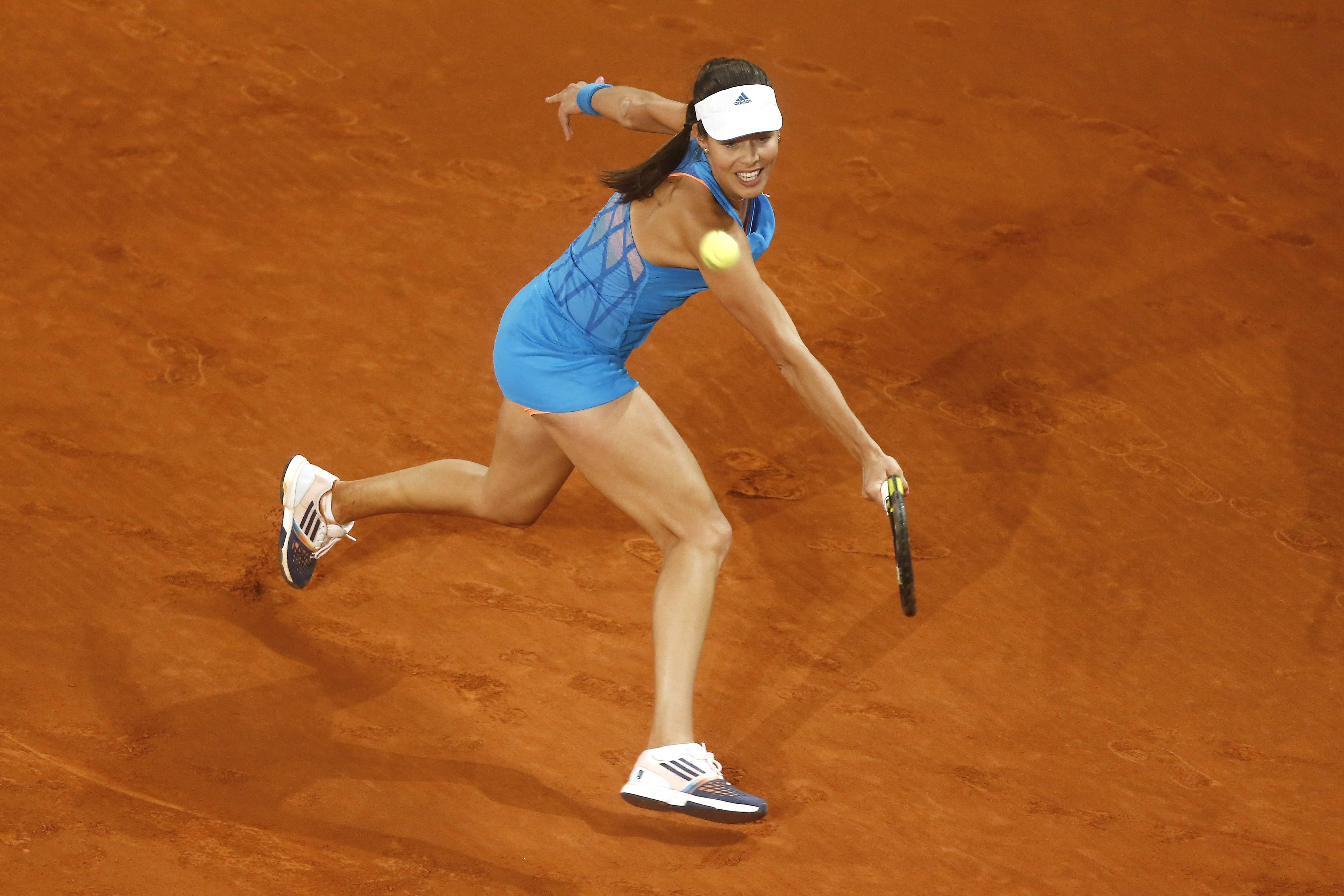 Ana Ivanovic from Serbia returns the ball during a Madrid Open tennis tournament match against Bojana Jovanovski from Serbia, in Madrid, Spain, Wednesday, May 7, 2014.