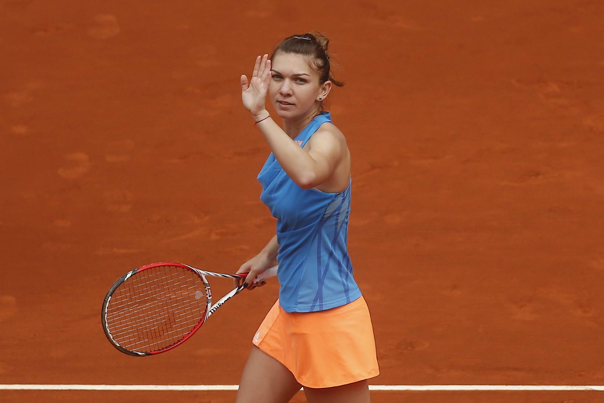 Simona Halep from Romania celebrates her victory against Lara Arruabarrena from Spain in a Madrid Open tennis tournament match in Madrid, Spain, Wednesday May 7, 2014.