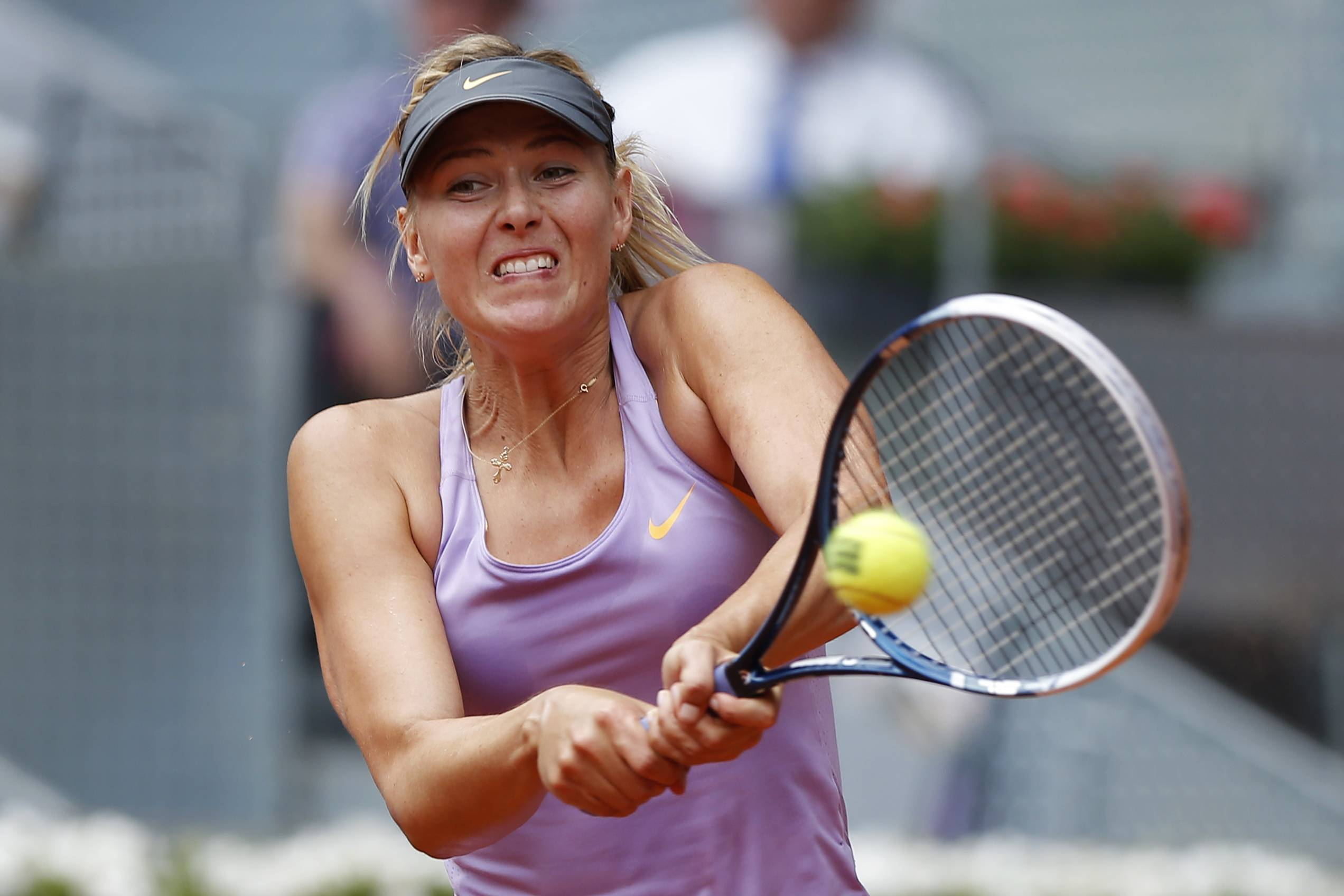 Maria Sharapova from Russia returns the ball to Christina McHale from U.S. during a Madrid Open tennis tournament match, in Madrid, Spain, Tuesday May 6, 2014.