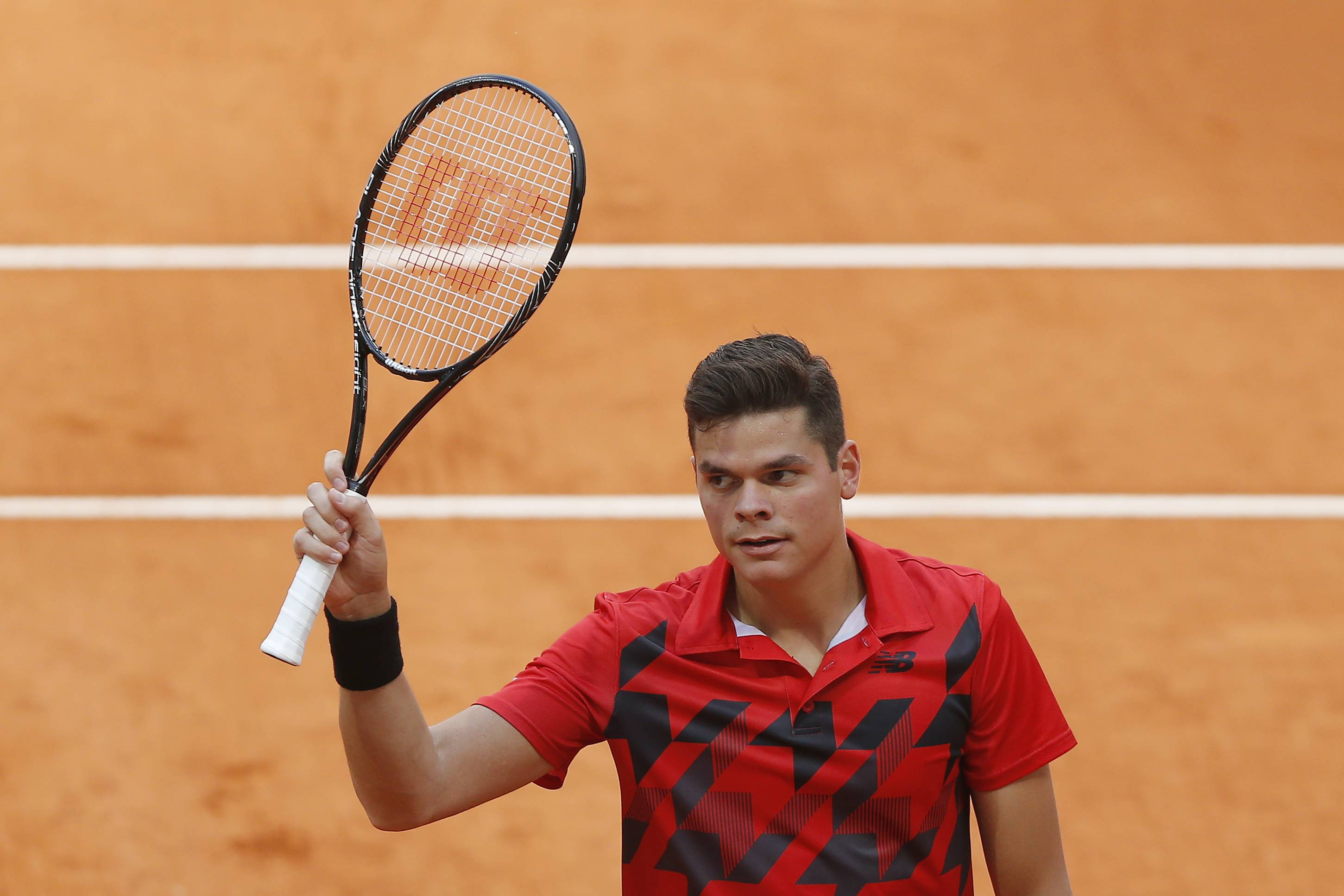 Milos Raonic from Canada celebrates his victory during a Madrid Open tennis tournament match against Jeremy Chardy from France, in Madrid, Spain, Tuesday, May 6, 2014.