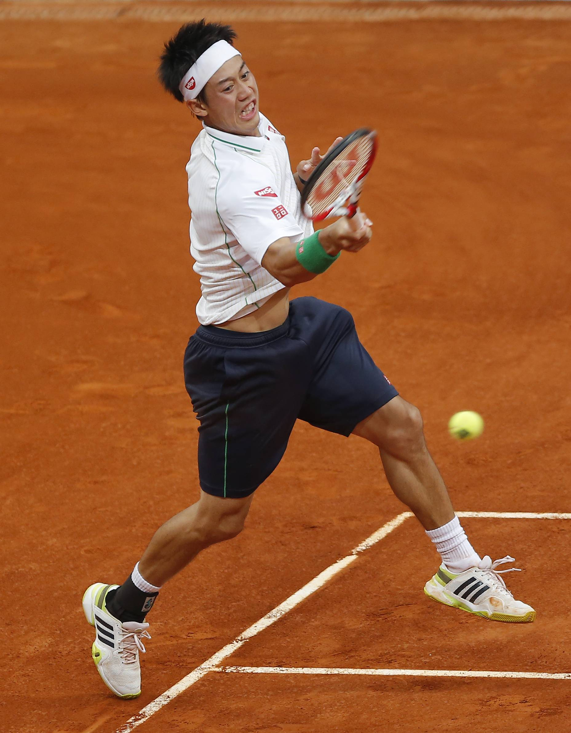 Kei Nishikori from Japan returns the ball during a Madrid Open tennis tournament match against Guillermo Garcia-Lopez from Spain, in Madrid, Spain, Tuesday, May 6, 2014.