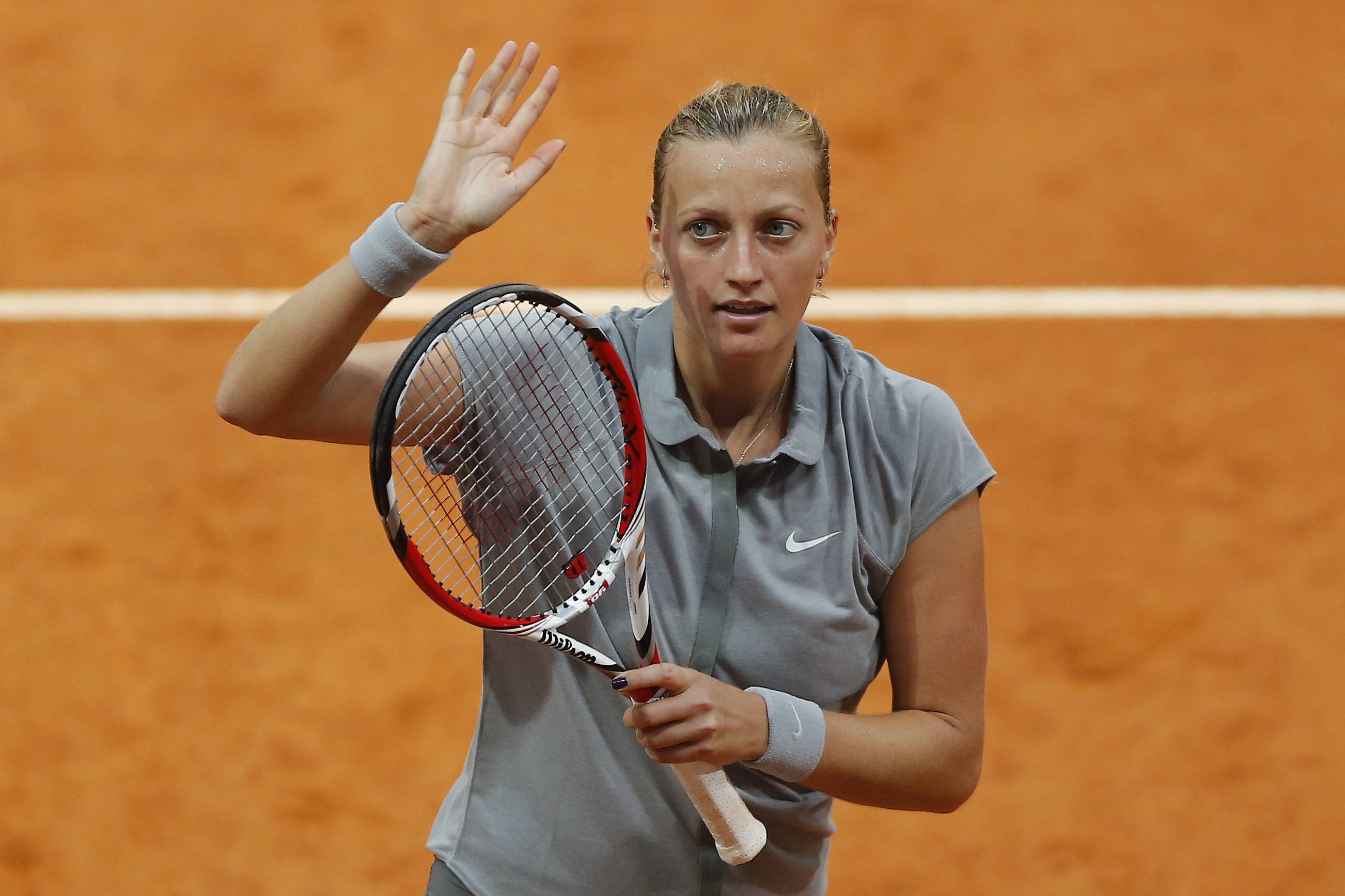 Petra Kvitova from the Czech Republic celebrates her victory during a Madrid Open tennis tournament match against Varvara Lepchenko from U.S., in Madrid, Spain, Tuesday, May 6, 2014.