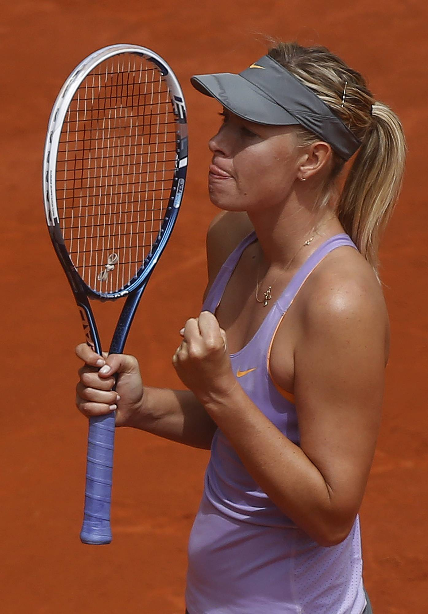 Maria Sharapova from Russia celebrates her victory against Christina McHale from U.S. during a Madrid Open tennis tournament match in Madrid, Spain, Tuesday May 6, 2014.