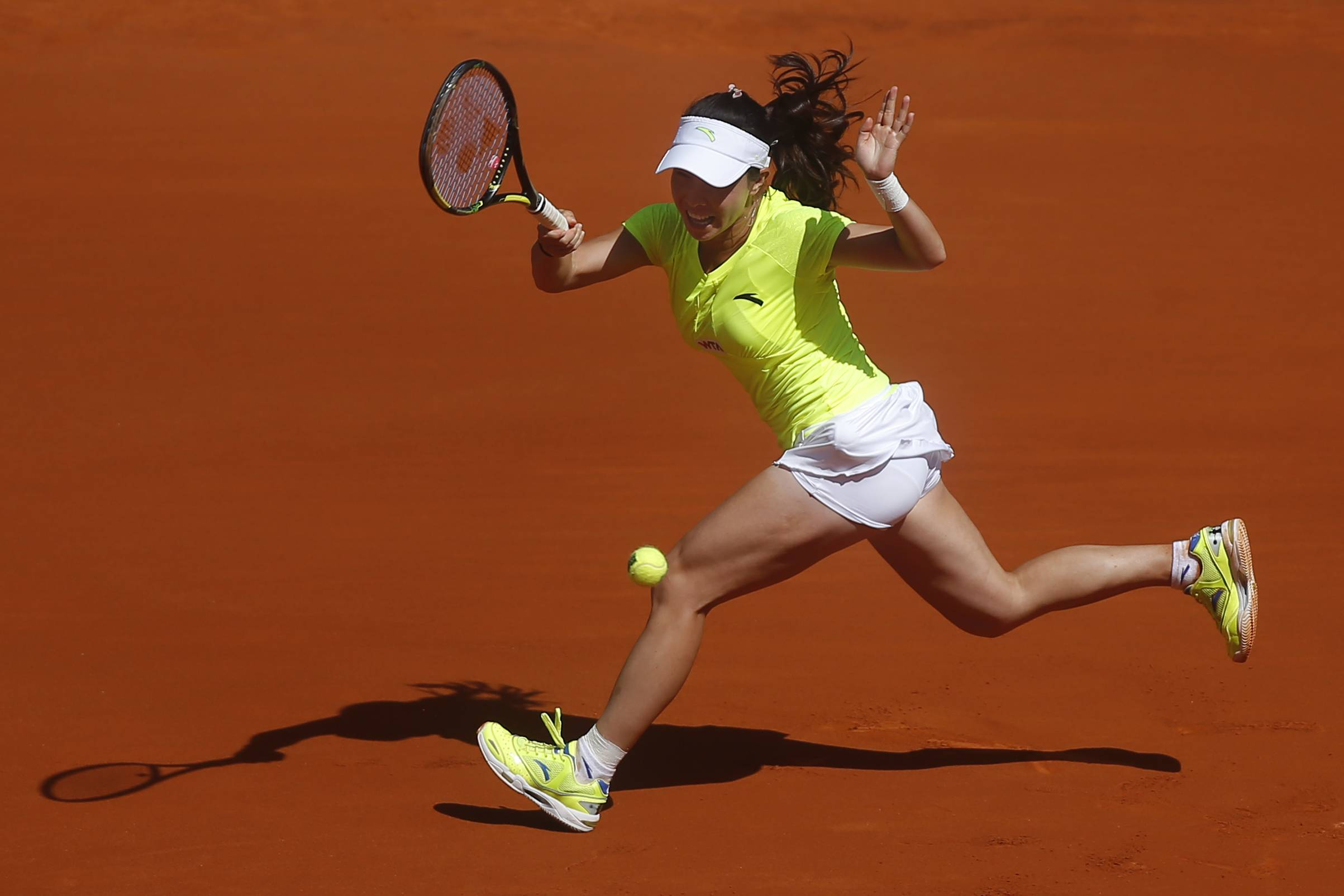 Jie Zheng from China serves during a Madrid Open tennis tournament match against Na Li from China, in Madrid, Spain, Tuesday May 6, 2014.