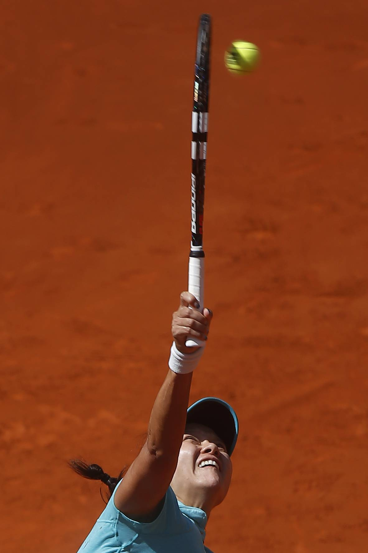 Li Na from China serves during a Madrid Open tennis tournament match against Jie Zheng from China, in Madrid, Spain, Tuesday, May 6, 2014.