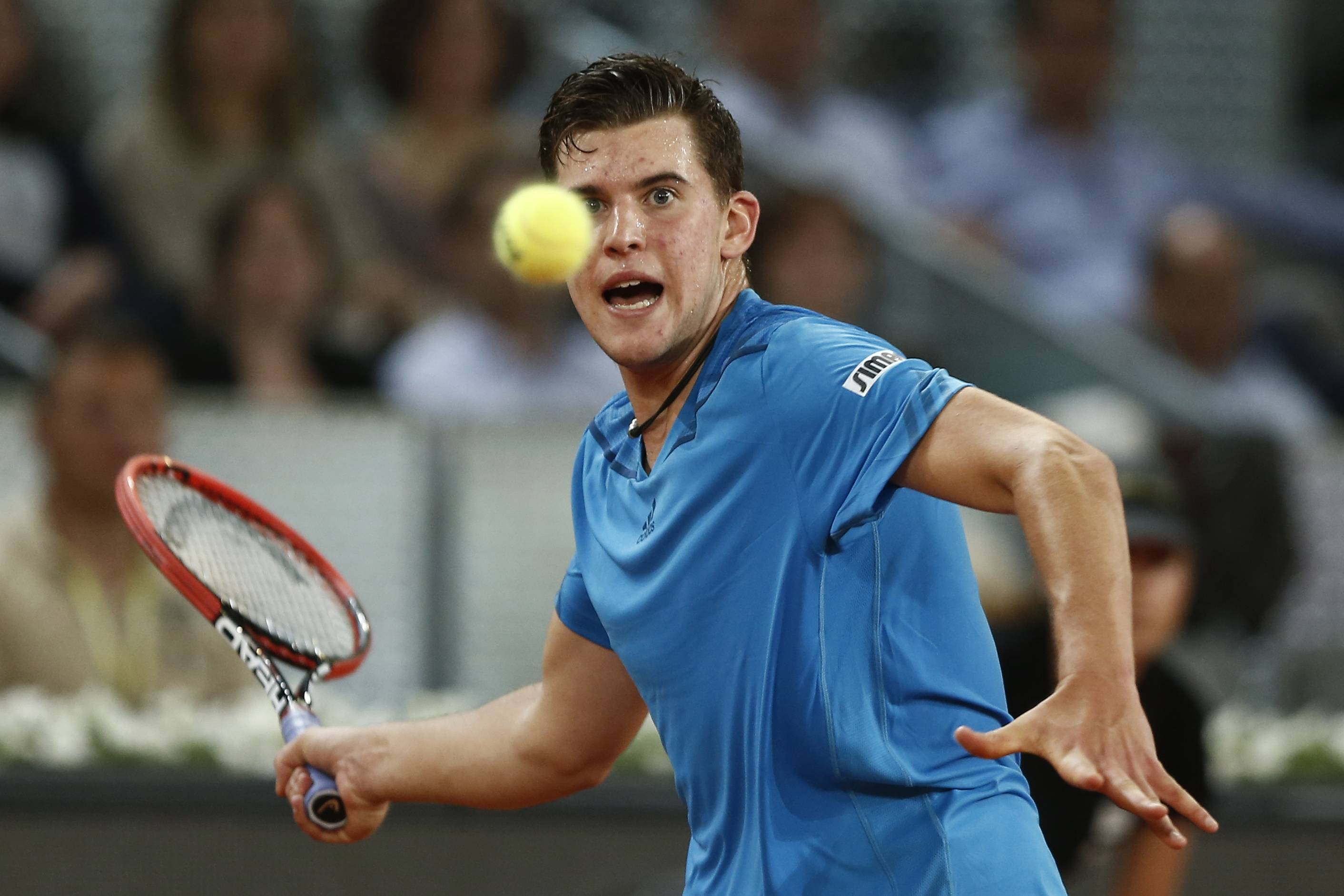 Dominic Thiem from Austria returns the ball during a Madrid Open tennis tournament match against Stanislas Wawrinka from Switzerland, in Madrid, Spain, Tuesday, May 6, 2014.