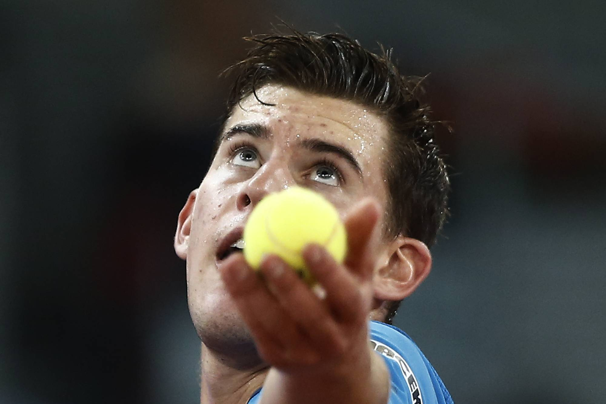 Dominic Thiem from Austria serves during a Madrid Open tennis tournament match against Stanislas Wawrinka from Switzerland, in Madrid, Spain, Tuesday, May 6, 2014.