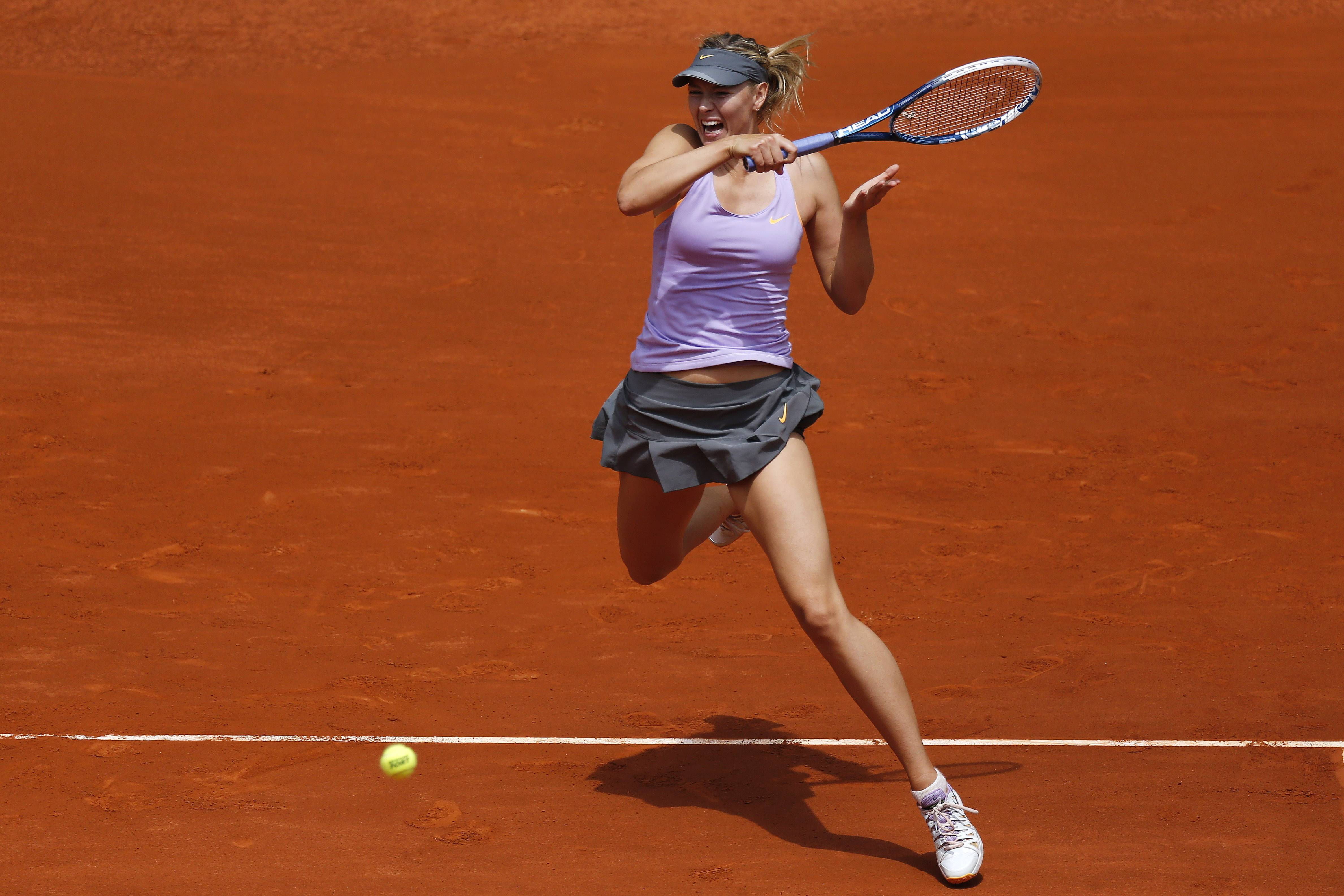 Maria Sharapova from Russia returns the ball during a Madrid Open tennis tournament match against Christina McHale from U.S., in Madrid, Spain, Tuesday, May 6, 2014.