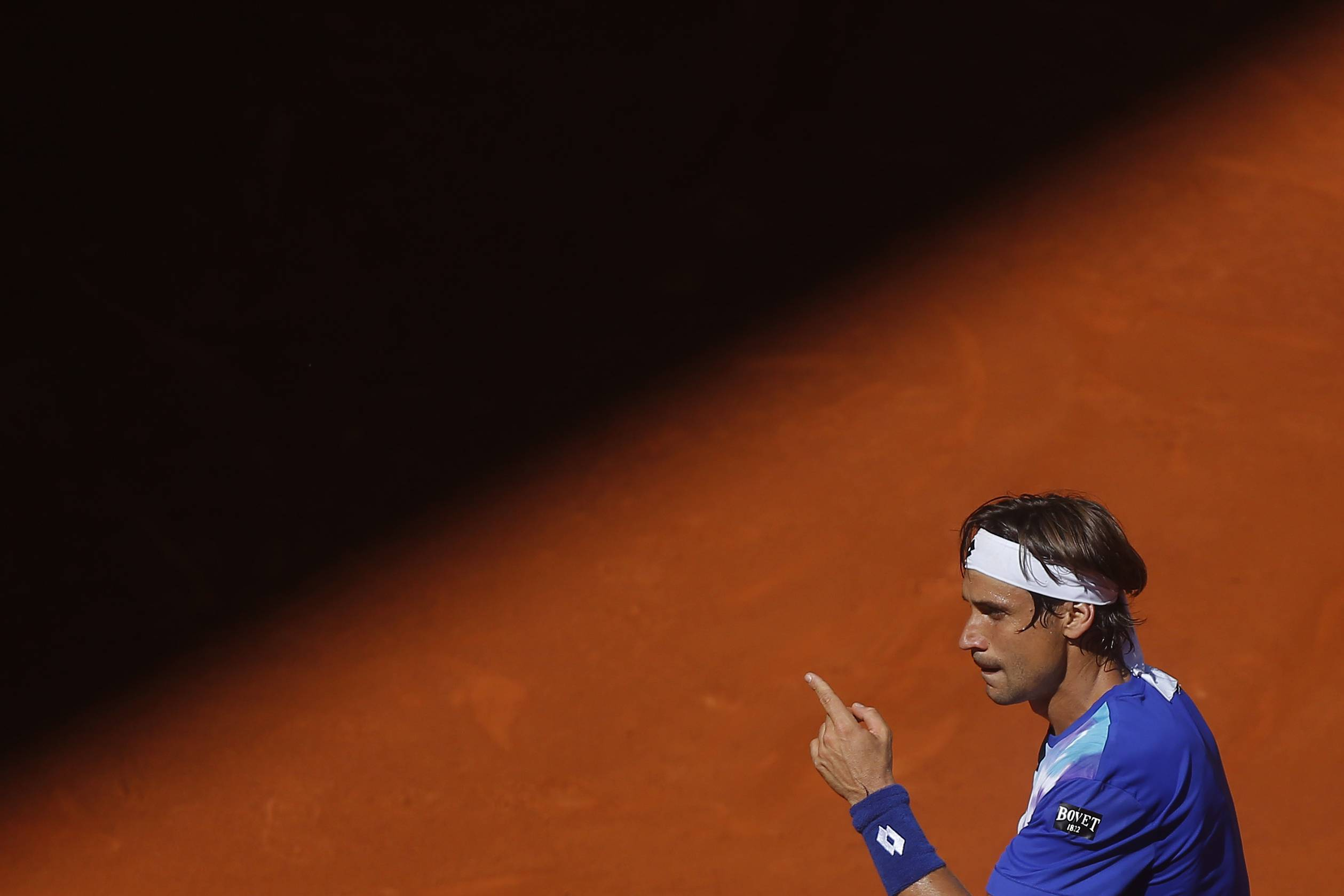 David Ferrer from Spain gestures during a Madrid Open tennis tournament match against Albert Ramos from Spain, in Madrid, Spain, Tuesday, May 6, 2014.