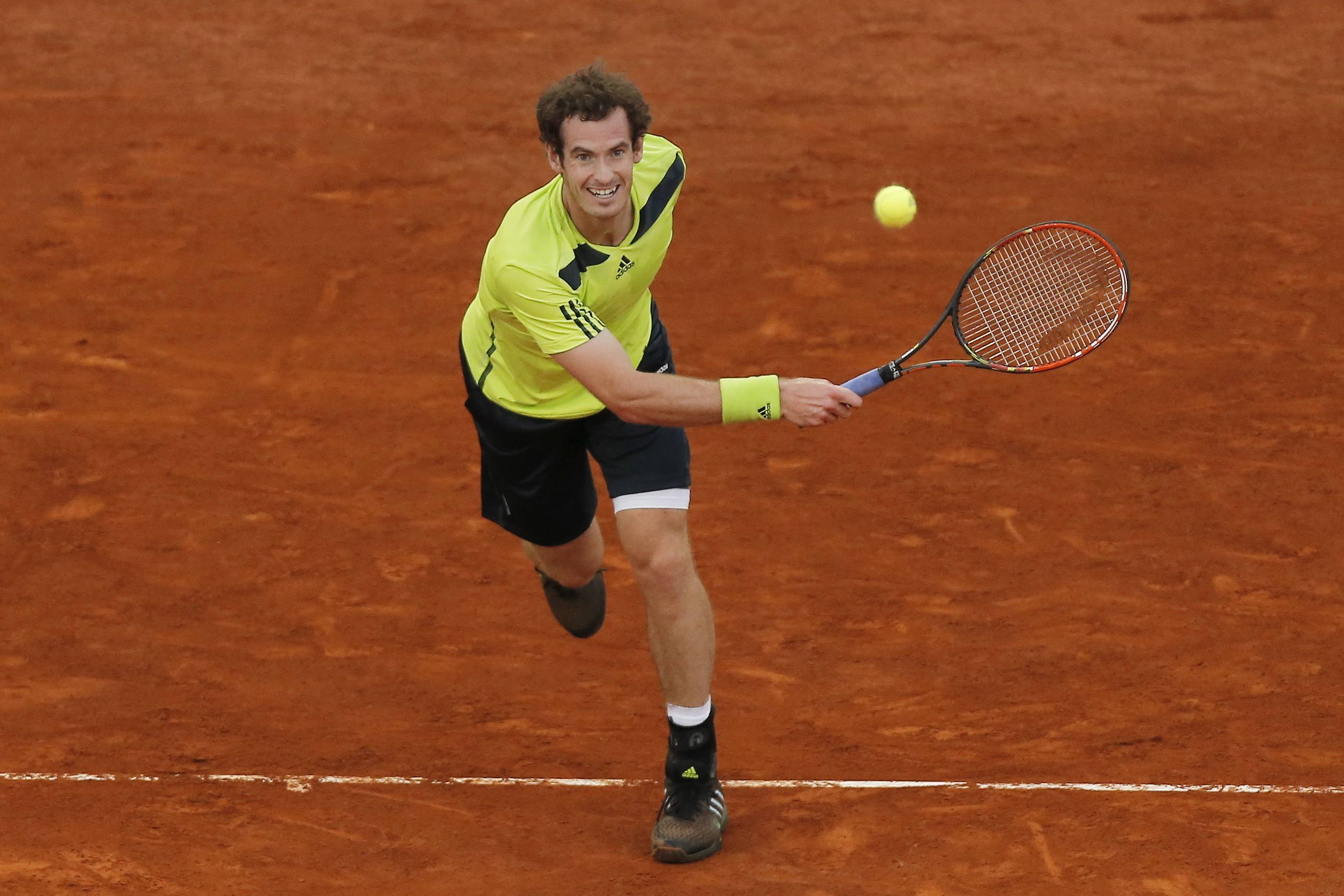 Britain's Andy Murray returns the ball during a Madrid Open tennis tournament match against Nicolas Almagro from Spain, in Madrid, Spain, Wednesday, May 7, 2014.