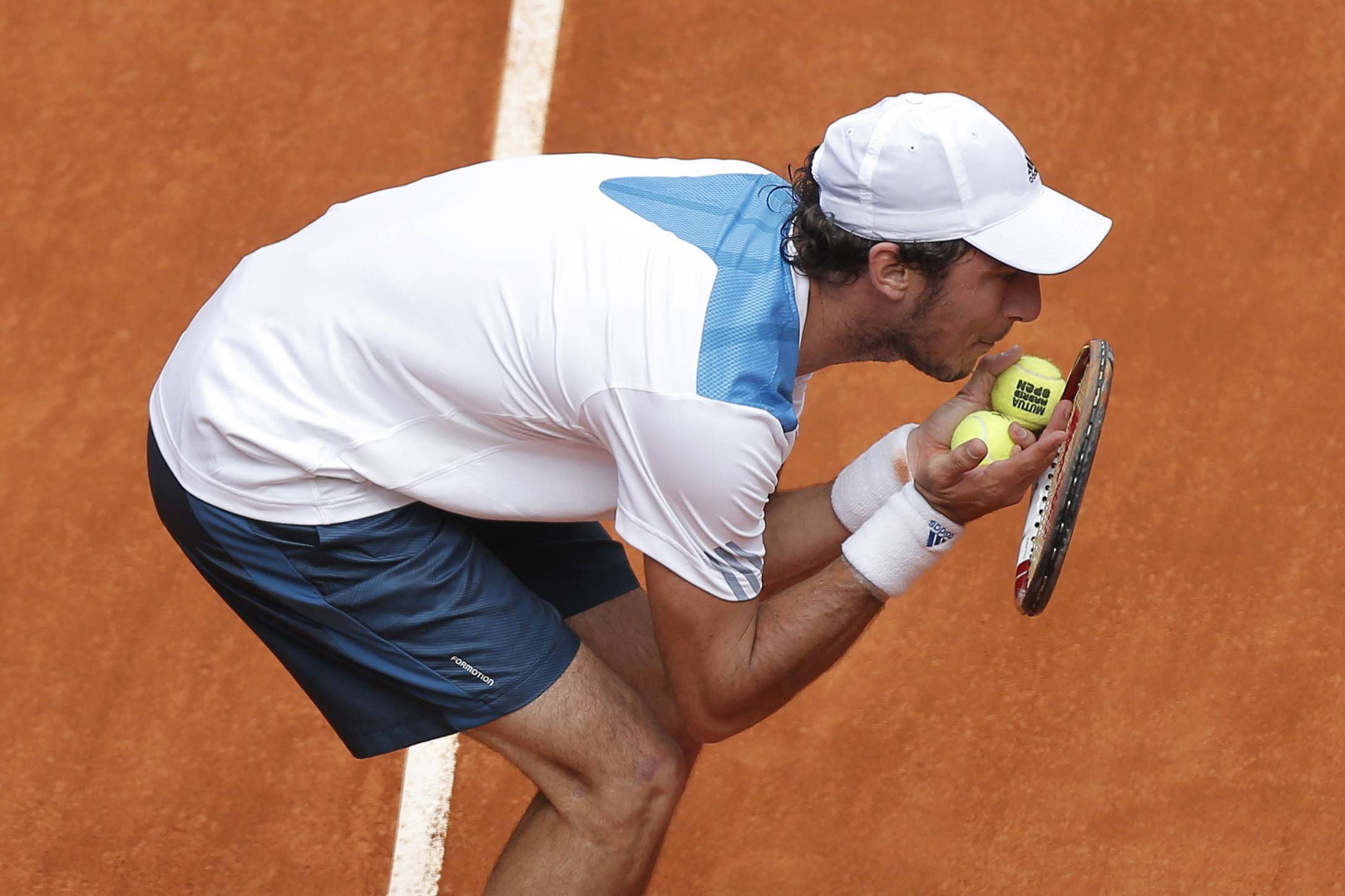 Juan Monaco from Argentina discusses a point with umpire Carlos Bernardes during a Madrid Open tennis tournament match against Rafael Nadal from Spain in Madrid, Spain, Wednesday, May 7, 2014.