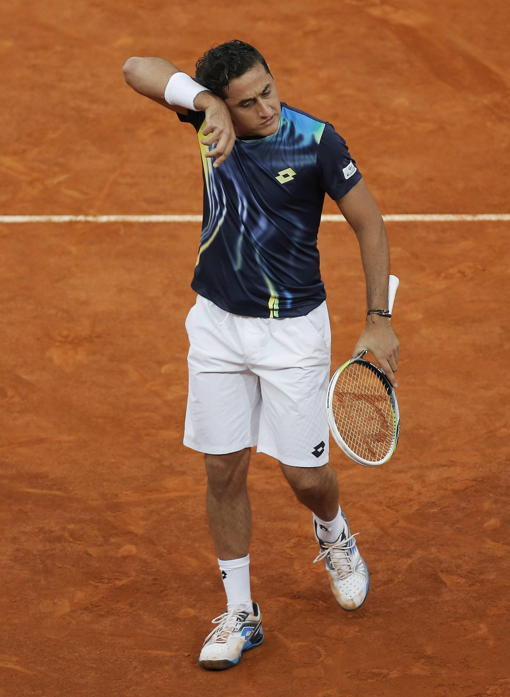 Nicolas Almagro from Spain reacts during a Madrid Open tennis tournament match against Britain's Andy Murray, in Madrid, Spain, Wednesday, May 7, 2014.