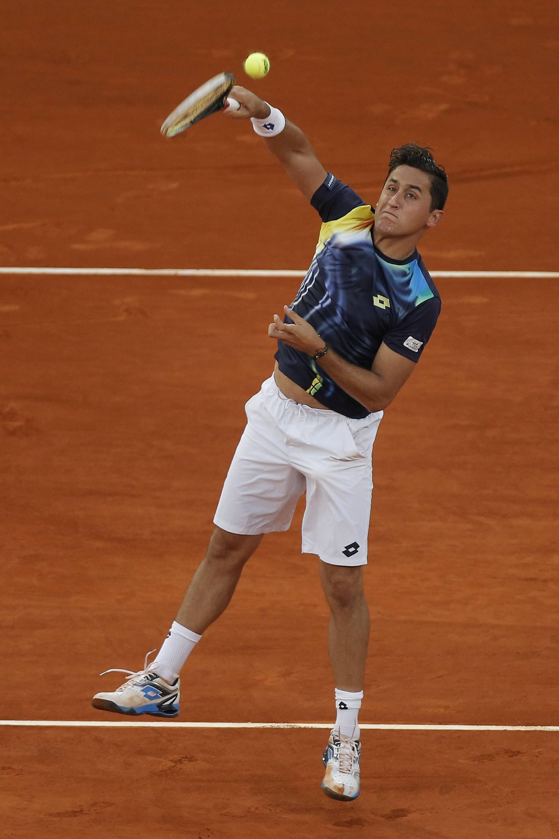 Nicolas Almagro from Spain returns the ball during a Madrid Open tennis tournament match against Britain's Andy Murray, in Madrid, Spain, Wednesday, May 7, 2014.