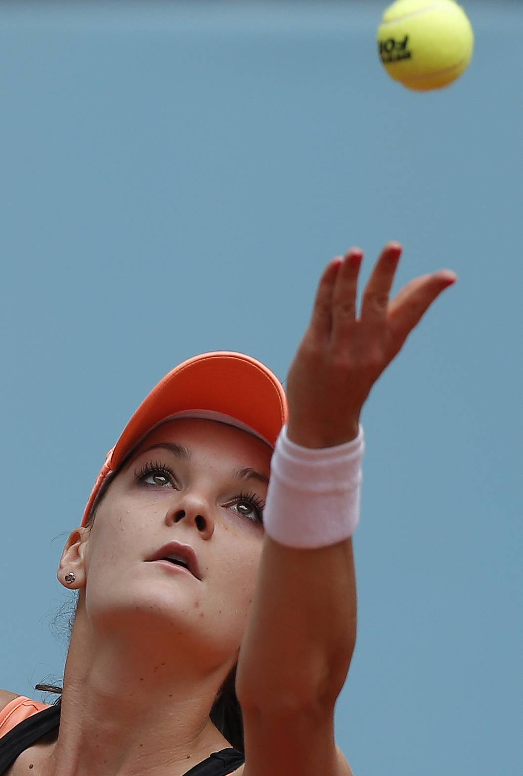 Agnieszka Radwanska from Poland serves during a Madrid Open tennis tournament match against Svetlana Kuznetsova from Russia, in Madrid, Spain, Wednesday, May 7, 2014.