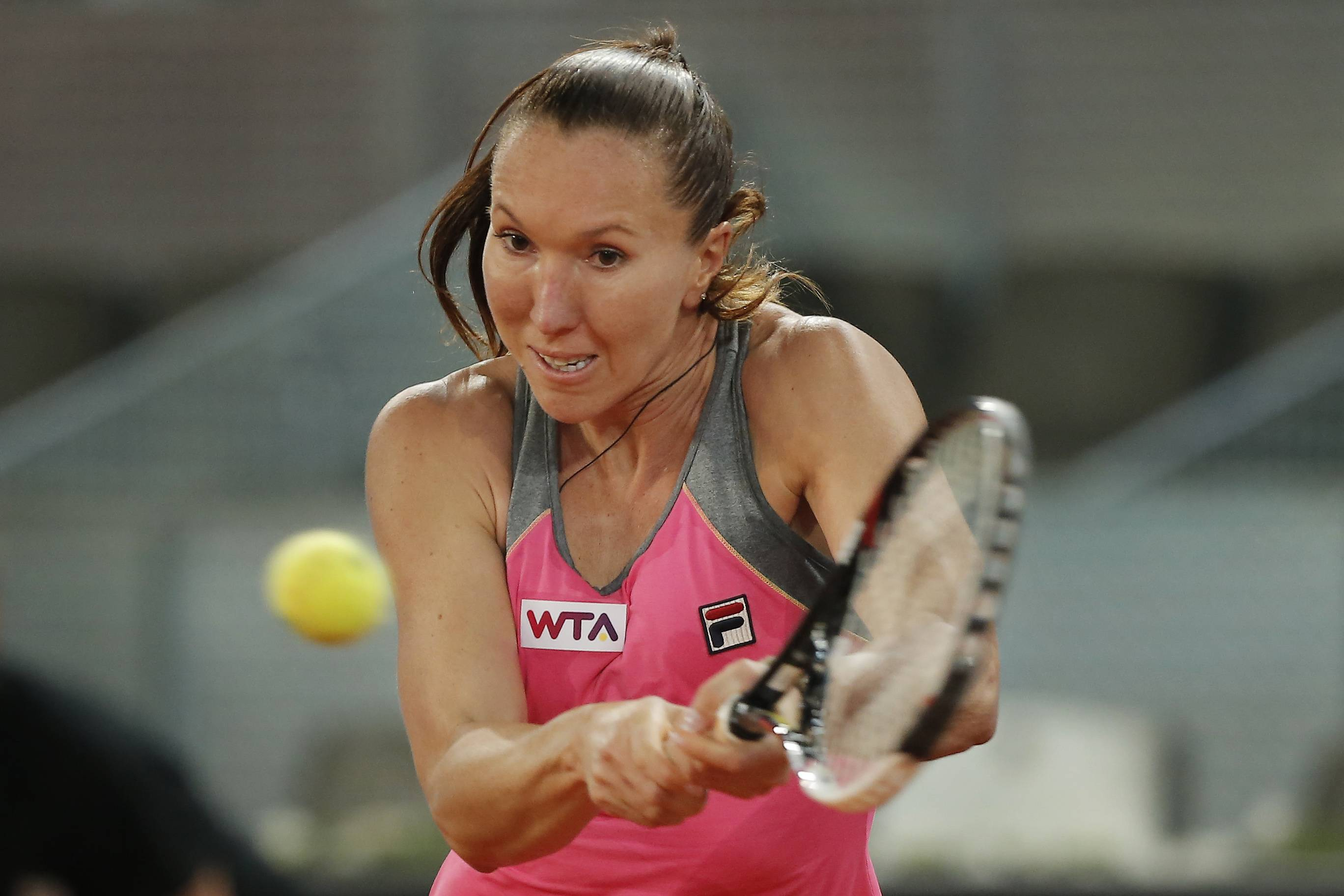 Jelena Jankovic from Serbia returns the ball during a Madrid Open tennis tournament match against Anastasia Pavlyuchenkova from Russia in Madrid, Spain, Thursday, May 8, 2014.