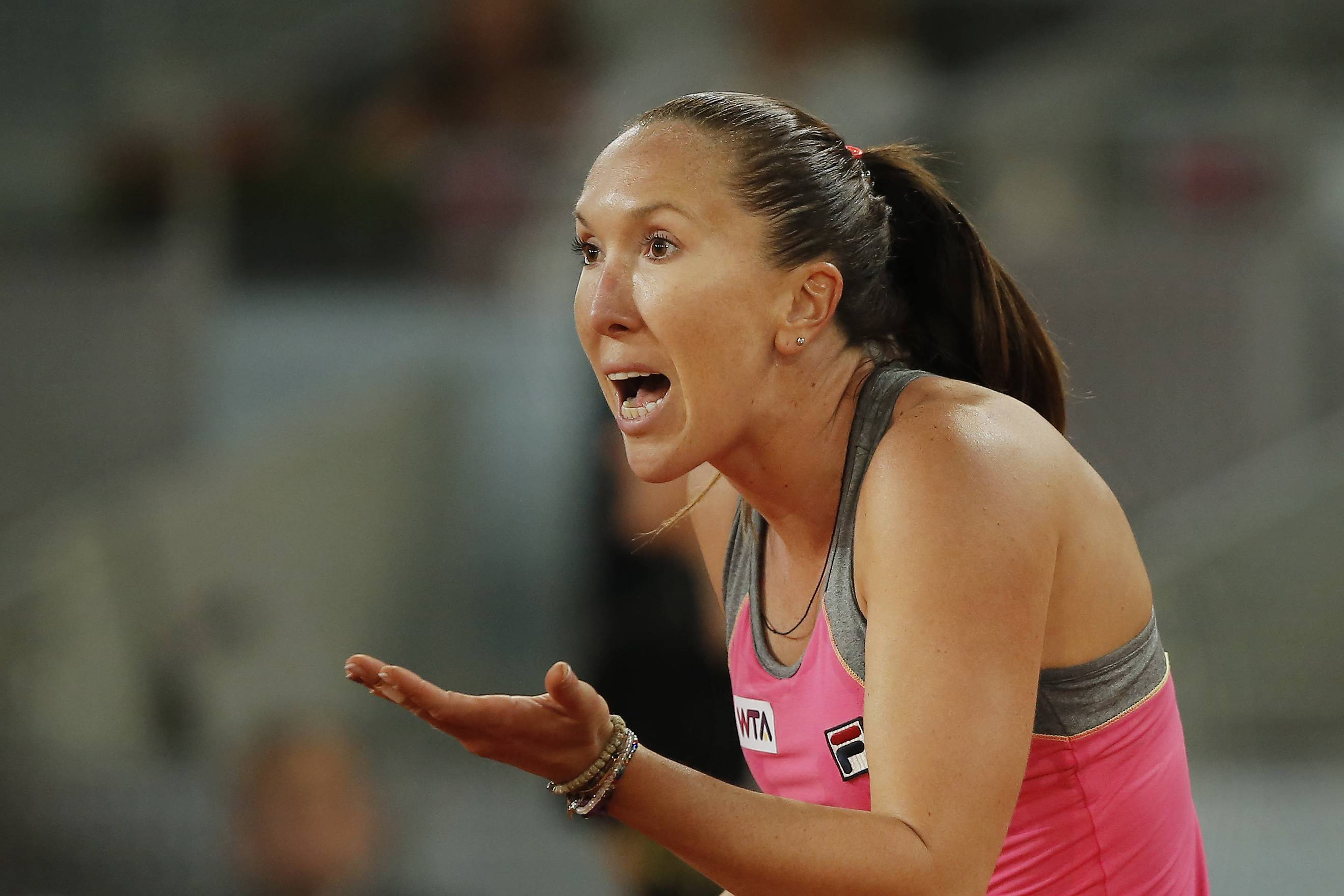 Jelena Jankovic from Serbia reacts during a Madrid Open tennis tournament match against Anastasia Pavlyuchenkova from Russia in Madrid, Spain, Thursday, May 8, 2014.