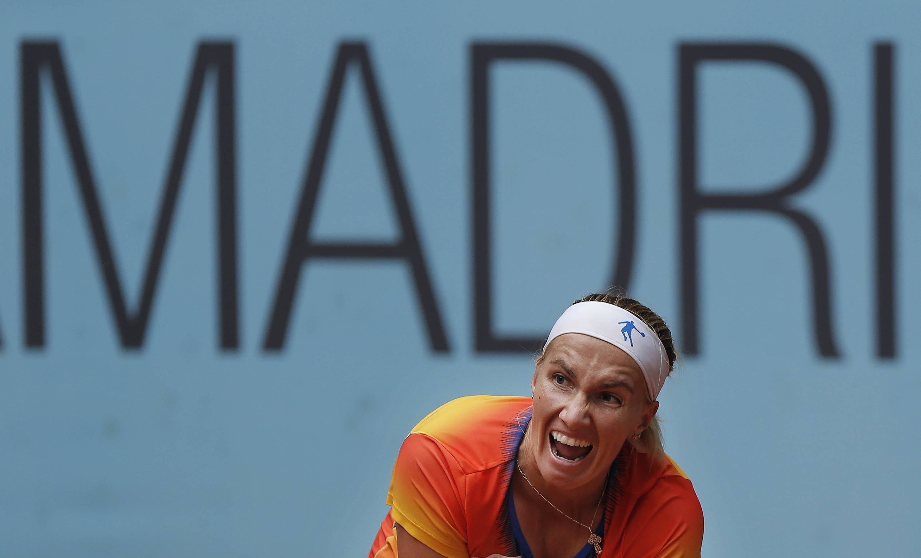 Svetlana Kuznetsova from Russia reacts during a Madrid Open tennis tournament match against Agnieszka Radwanska from Poland, in Madrid, Spain, Wednesday, May 7, 2014.