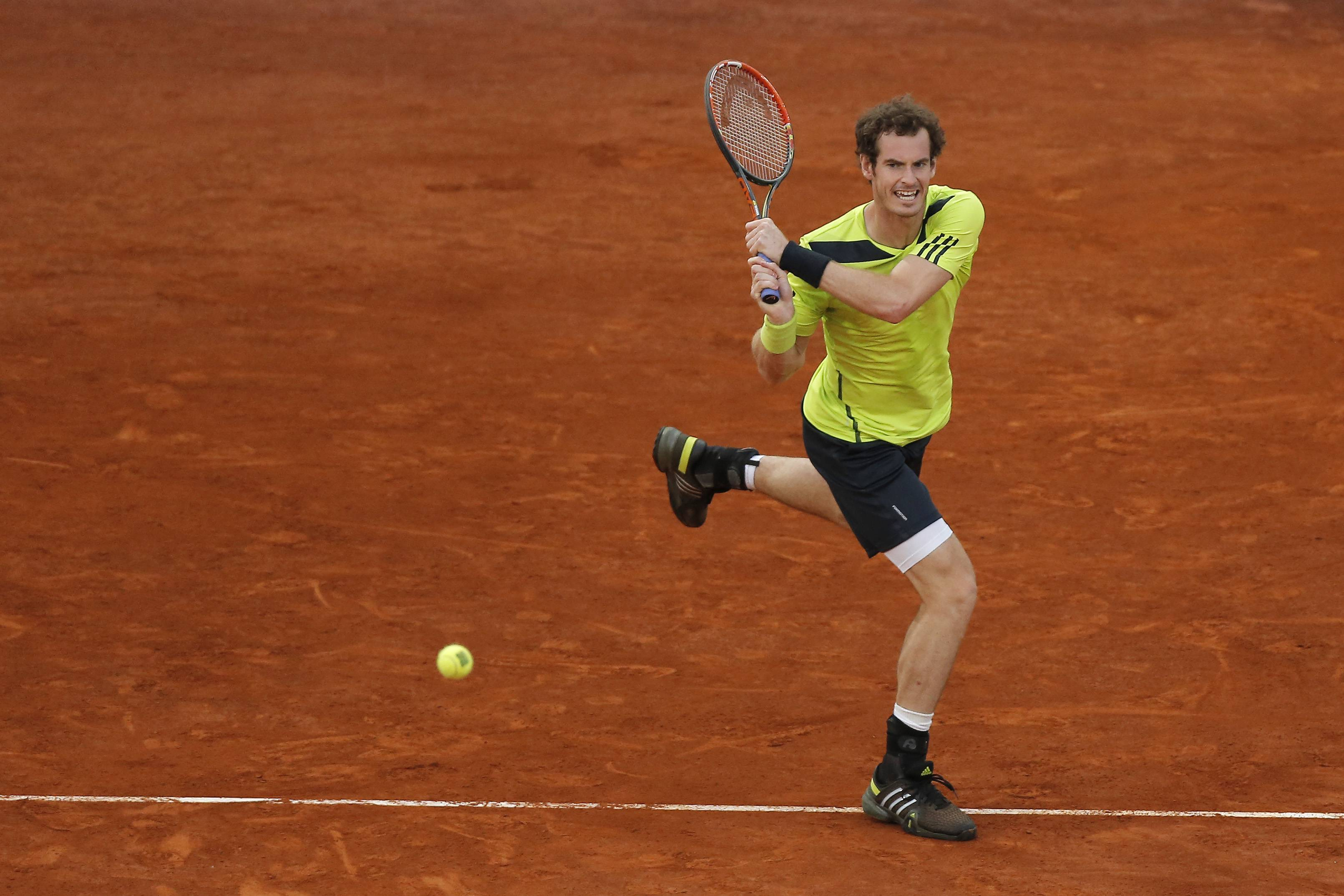 Andy Murray from Britain returns the ball during a Madrid Open tennis tournament match against Nicolas Almagro from Spain, in Madrid, Spain, Wednesday, May 7, 2014.