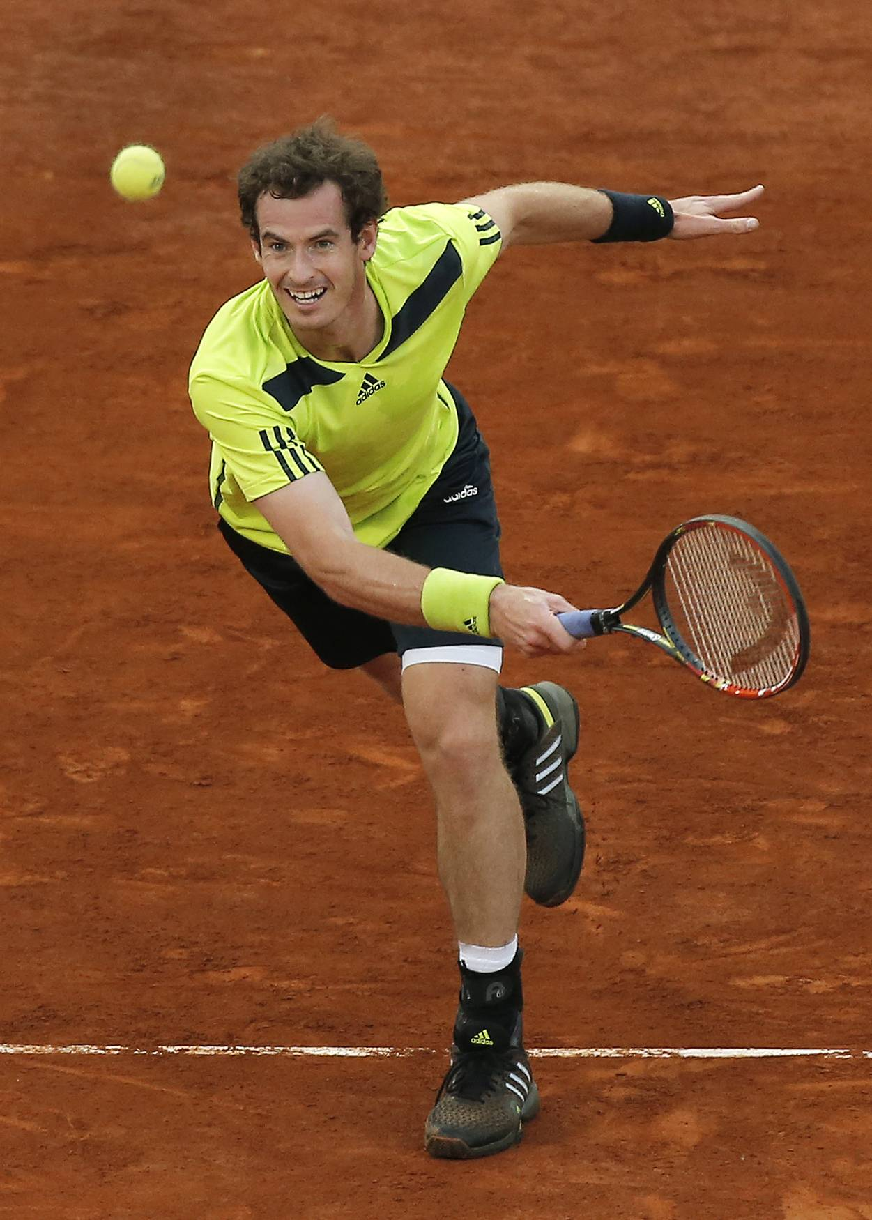 Andy Murray returns the ball during a Madrid Open tennis tournament match against Nicolas Almagro from Spain, in Madrid, Spain, Wednesday, May 7, 2014.