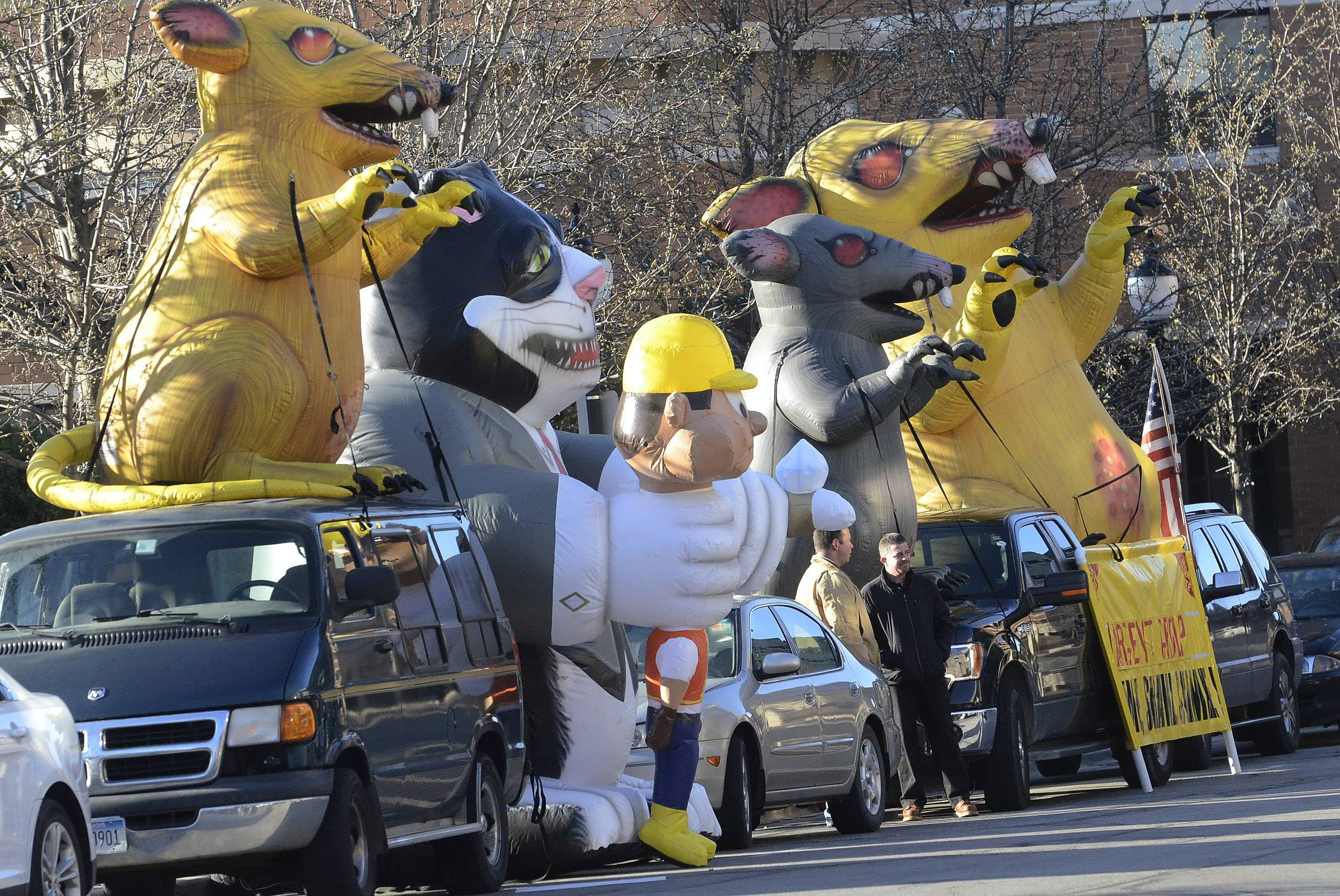 The inflatable rats, here in downtown Arlington Heights to protest nonunion labor on the Arlington Downs project, have moved on.