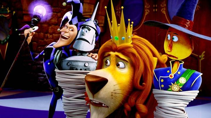 "The Jester (Martin Short) captivates Tin Man (Kelsey Grammer), Lion (Jim Belushi) and Scarecrow (Dan Aykroyd) in the animated musical ""Legends of Oz: Dorothy's Return."""