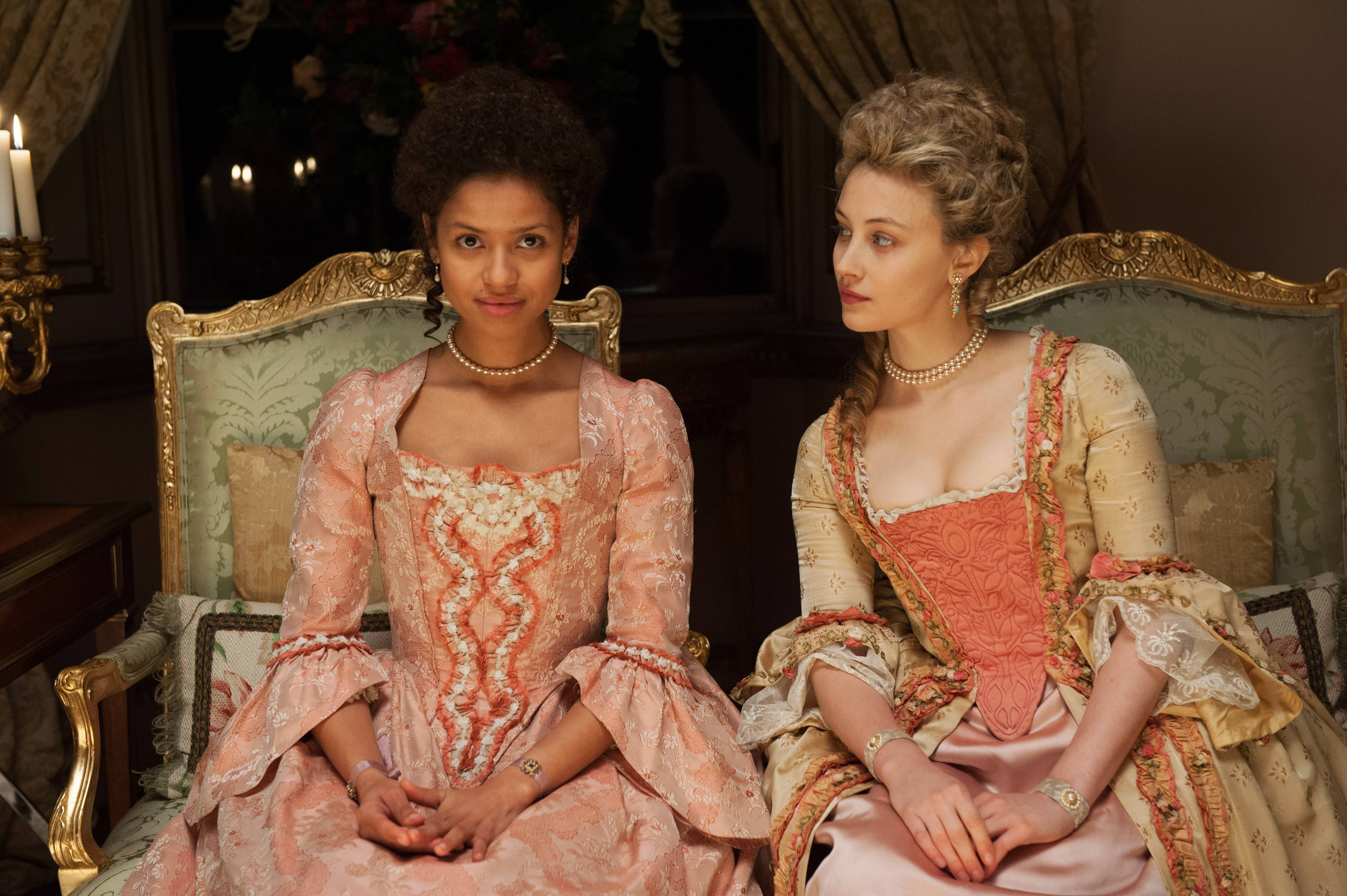"The biracial Dido Elizabeth Belle (Gugu Mbatha-Raw, left) strikes up an unusual friendship with the white Lady Elizabeth Murray (Sarah Gadon) in 18th century England in the based-on-fact movie ""Belle."""
