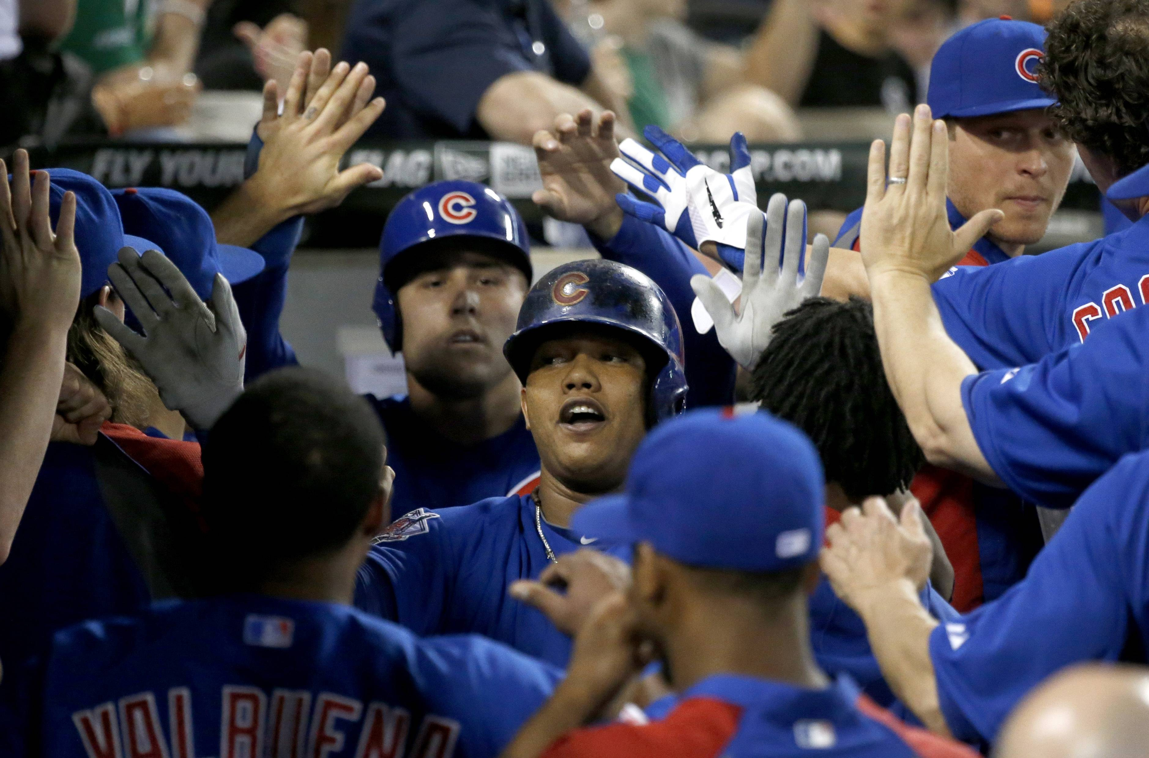 Starlin Castro is congratulated in the Cubs' dugout after his 2-run homer off White Sox starter Scott Carroll in the fourth inning Thursday night.