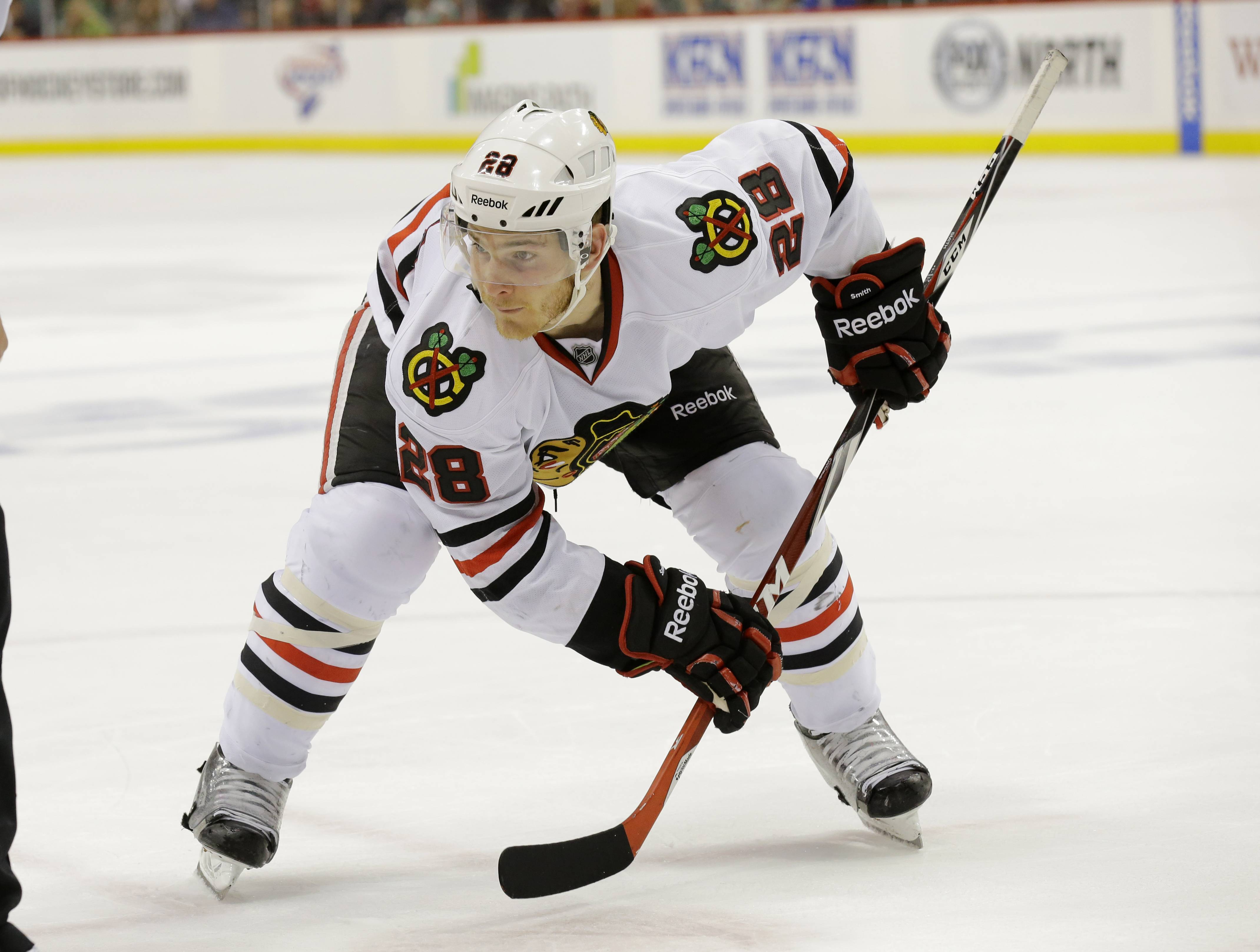 Ben Smith will skate on the Blackhawks' top line with Jonathan Toews and Bryan Bickell in Friday night's Game 4 against the Wild.