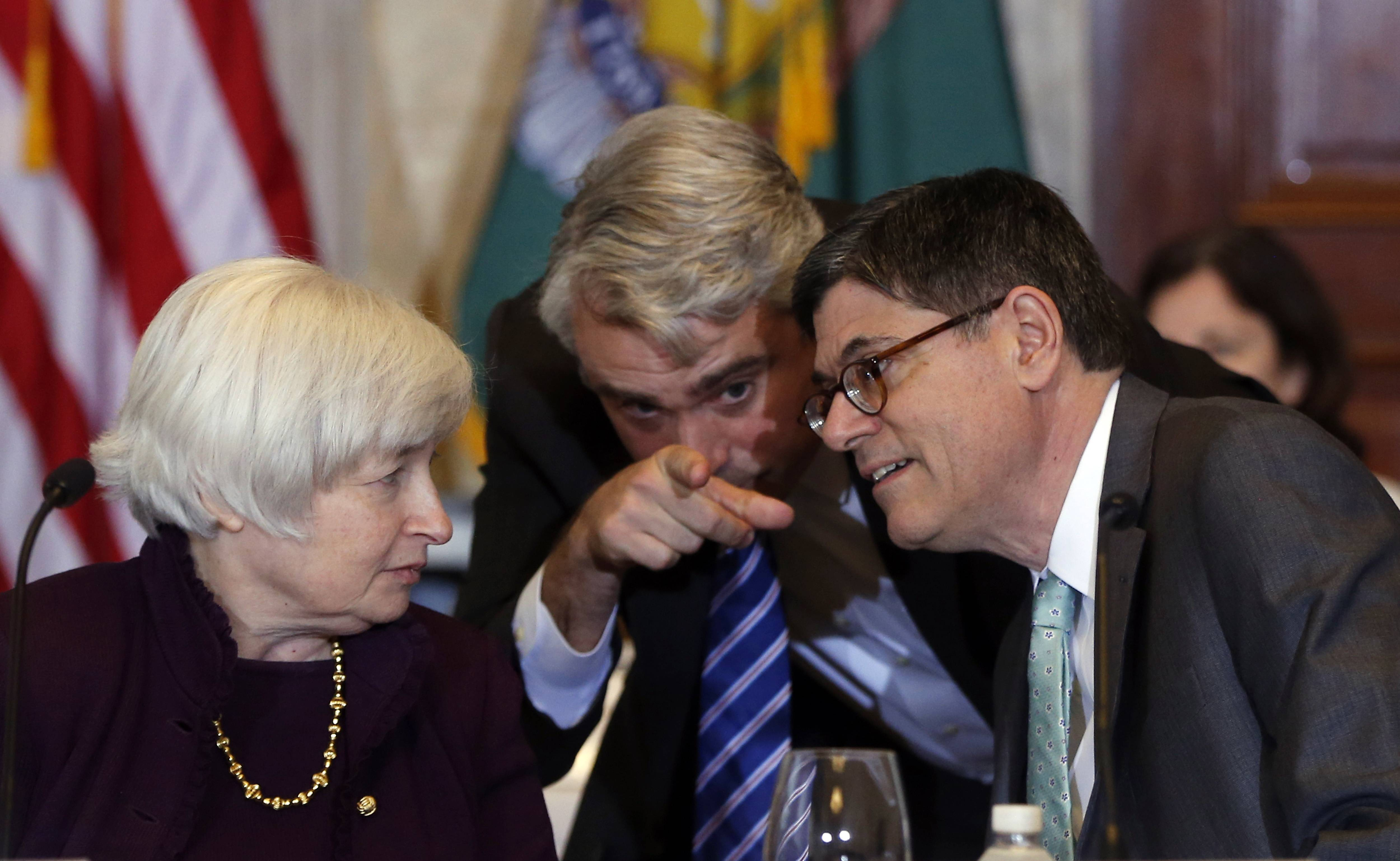 Treasury Secretary Jacob Lew, right, Patrick Pinschmidt, Executive Director of the Financial Stability Oversight Council, and Federal Reserve Chair Janet Yellen, left, huddle before the start of an open meeting of the Financial Stability Oversight Council, which monitors risk to the U.S. financial system, at the Treasury Department in Washington, Wednesday.