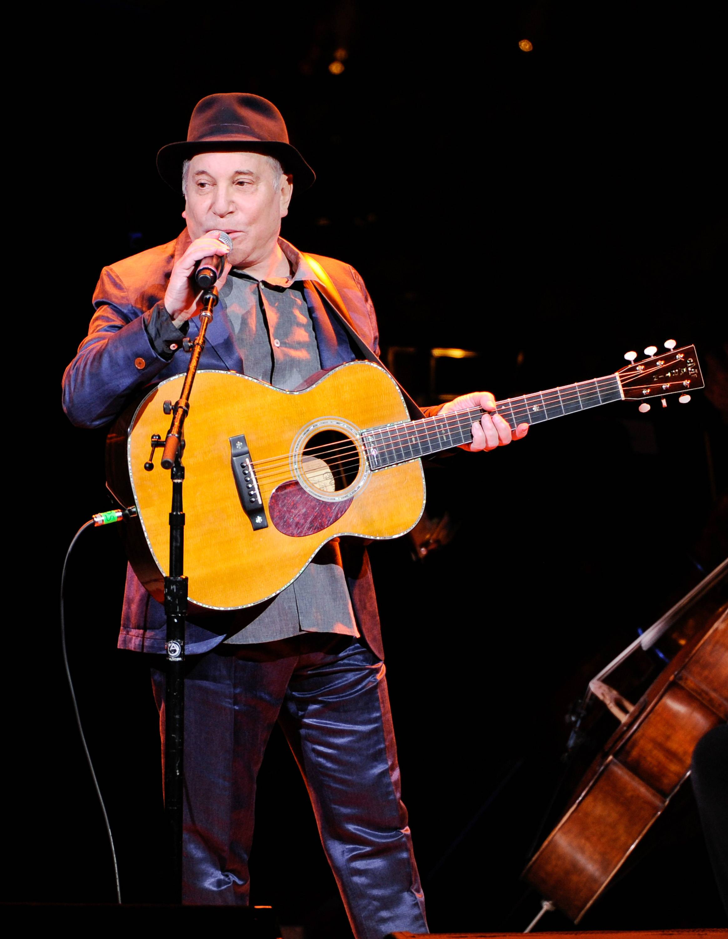Paul Simon performed more than a dozen songs Wednesday at the Beacon Theatre in New York, where he was honored at the 2014 NYU Steinhardt Vision Award Gala. It was Simon's first public appearance since he and wife Edie Brickell were arrested on disorderly conduct charges.