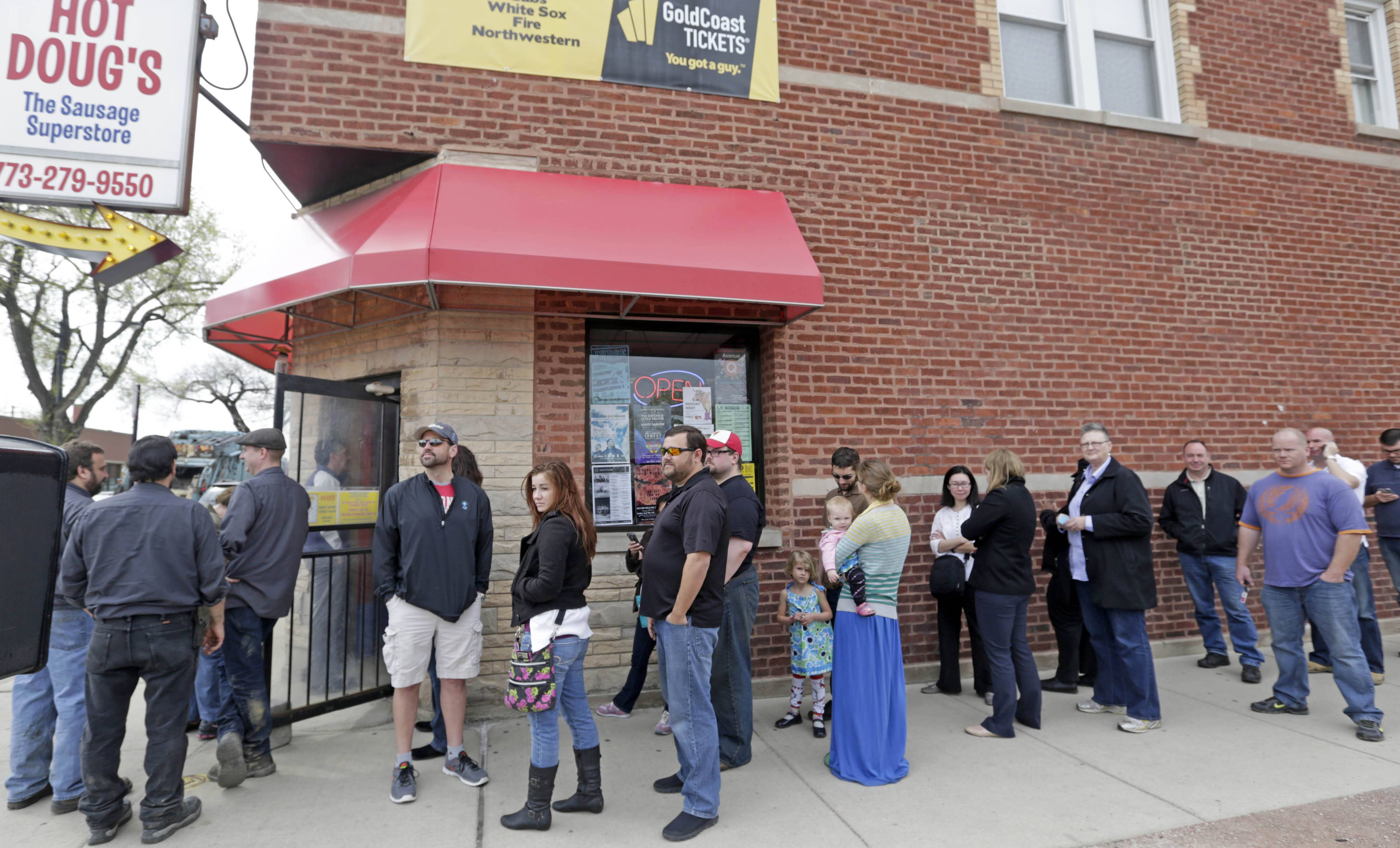 Customers line up Wednesday outside Hot Doug's in Chicago. The establishment has become a must-stop destination for both locals and wiener fans from around the country.