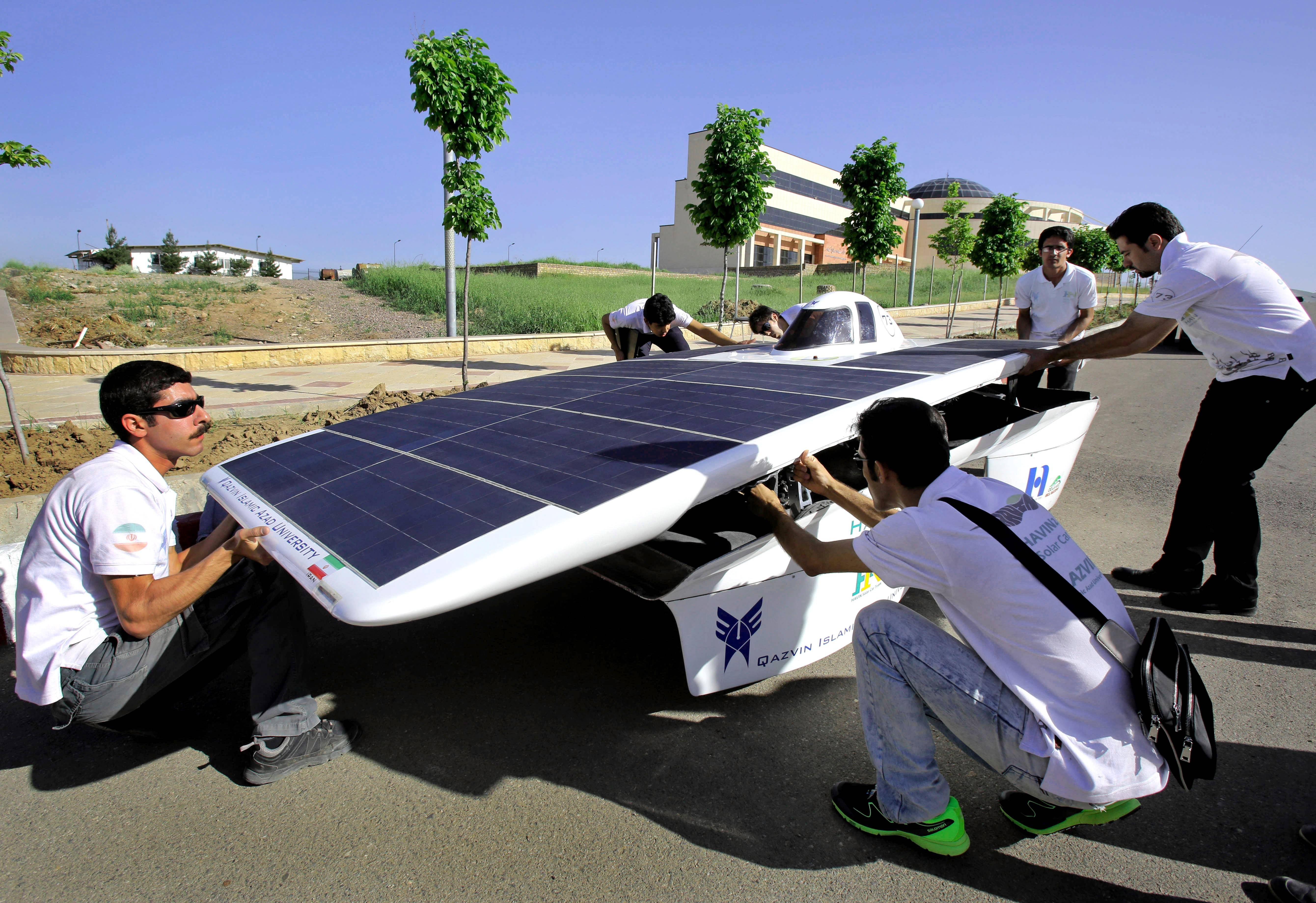 Iranian university students assemble the Havin-2, or Brilliant Sun, for a test drive in Qazvin, Iran. A group of Iranian students and their teachers geared up for a summer road trip through the American heartland, fueled only by the sun and their hopes to shine in what will be a first for the Islamic Republic.
