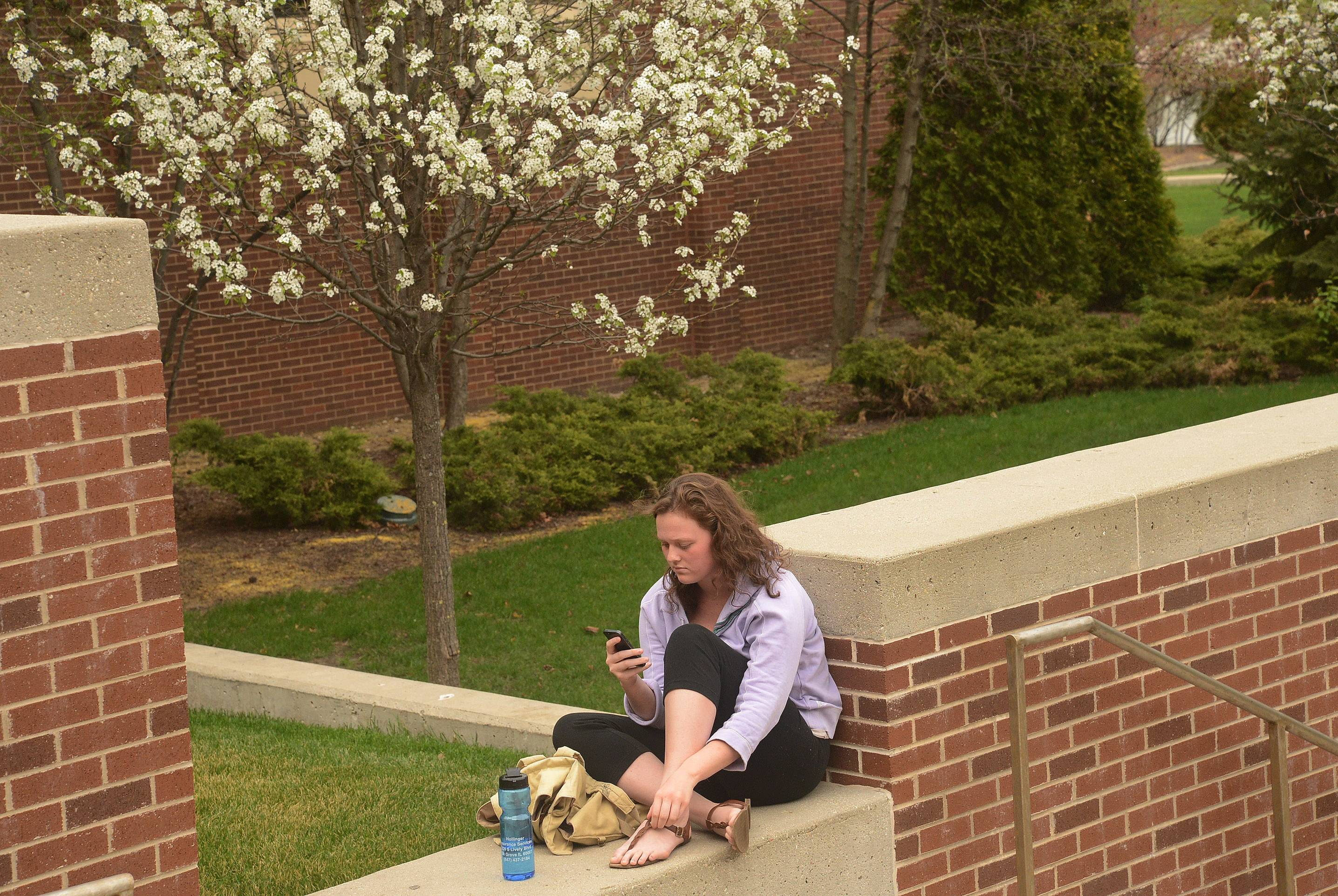 Bridget Barry of Barrington relaxes outdoors at Harper College in Palatine.