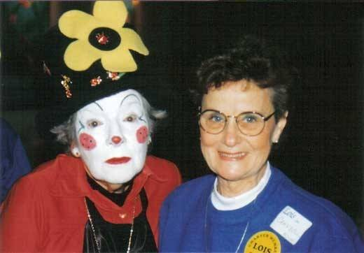 In this file photo from the Lois Club archives, former Naperville resident Lois Schnizlein dons her Lady Bugg clown persona as she mingles with Lois Campbell of Wisconsin during a Lois Club convention.