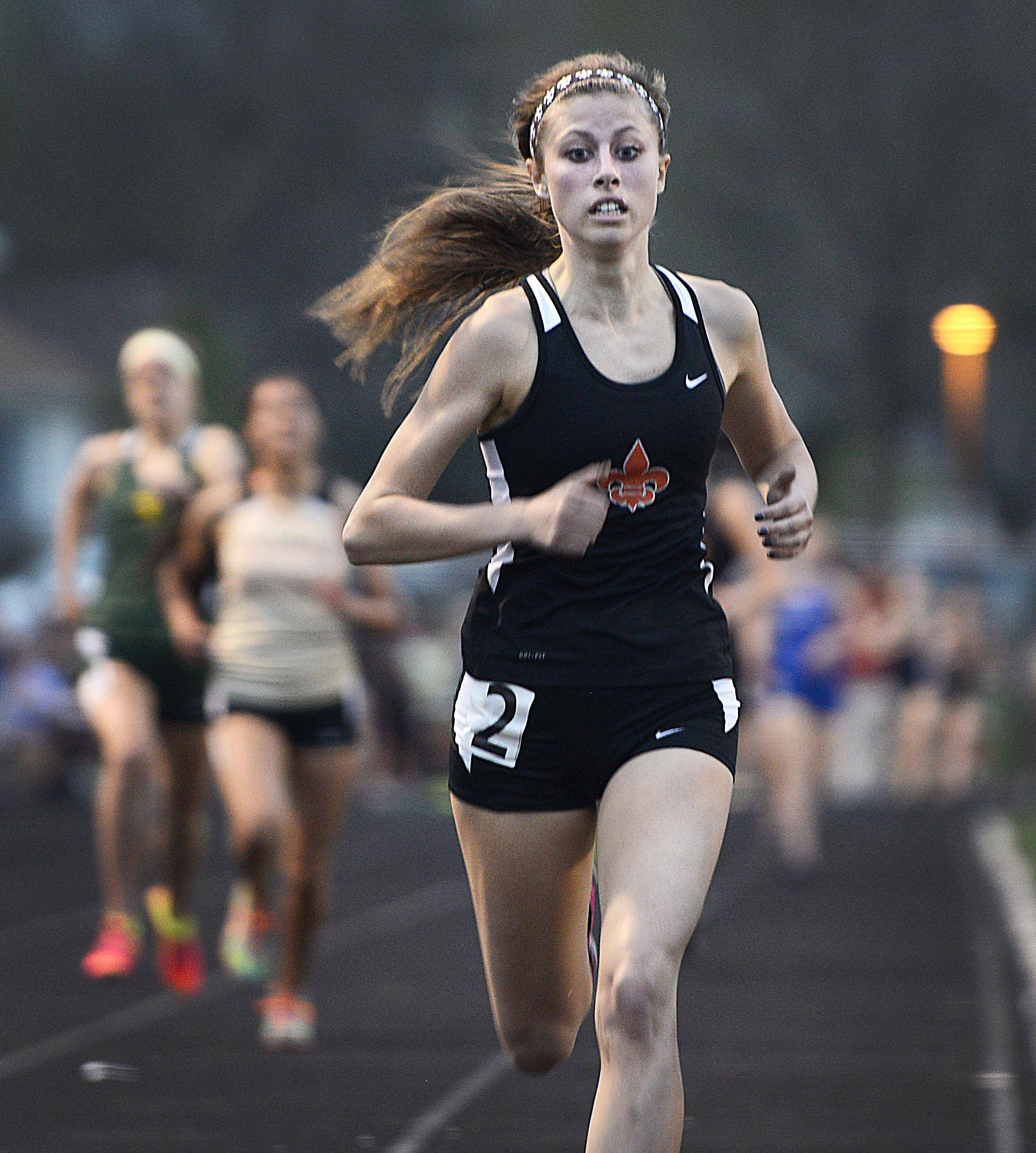 St. Charles East's Toree Scull wins the 1,600 meter run Thursday at the Upstate Eight Conference girls track meet at Geneva High School.