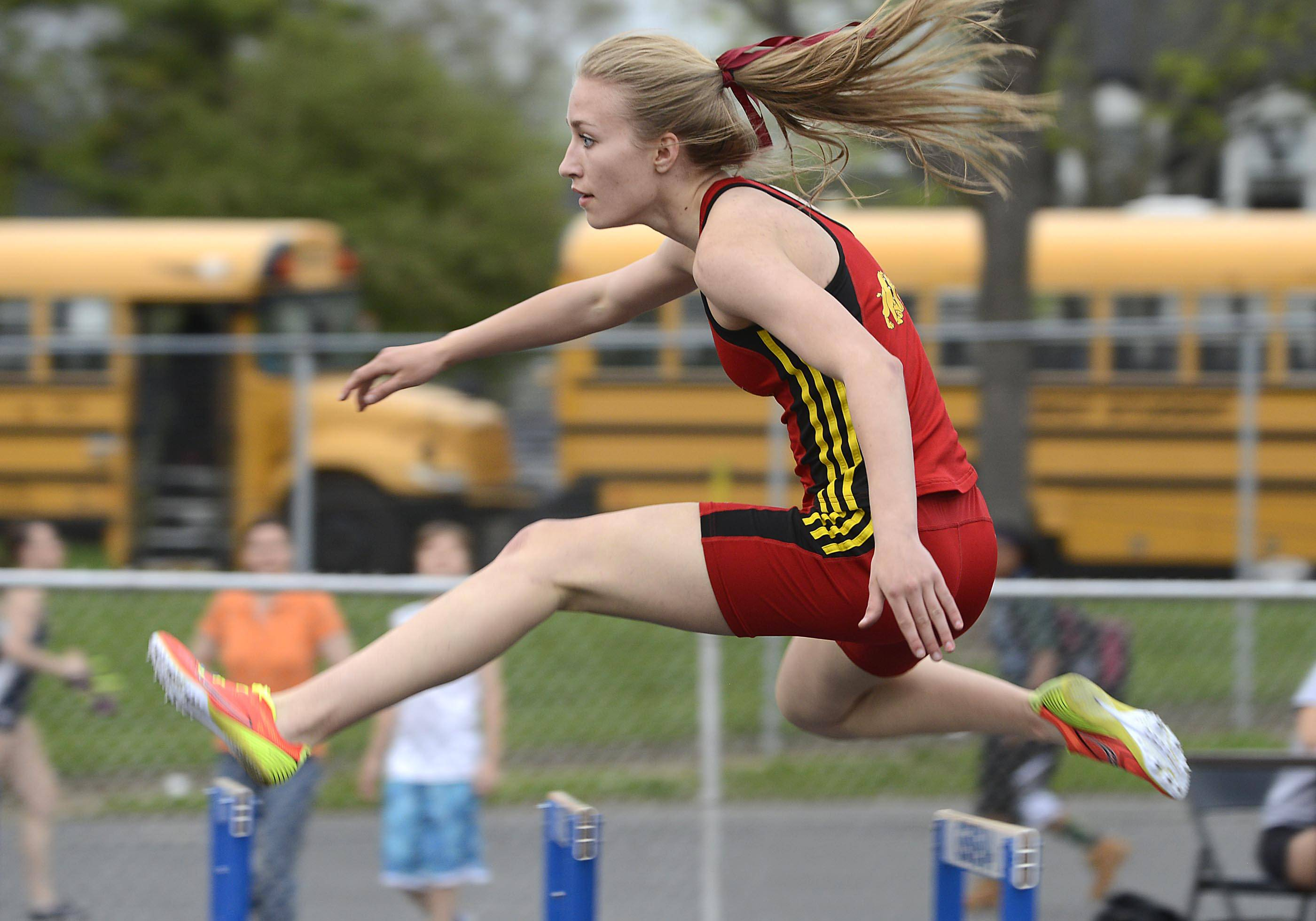 Batavia's Taylor Stieve competes in the 300 meter hurdles Thursday at the Upstate Eight Conference girls track meet at Geneva High School.