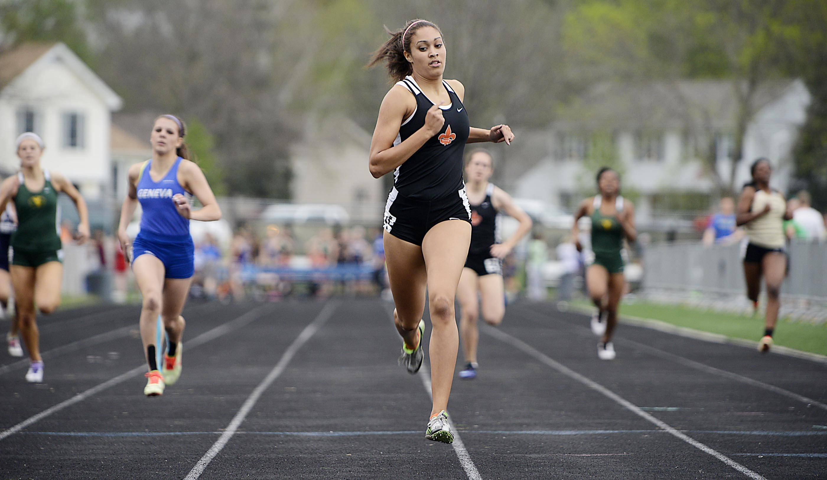 St. Charles East's Jordan Shead wins the 400 meter run Thursday at the Upstate Eight Conference girls track meet at Geneva High School.