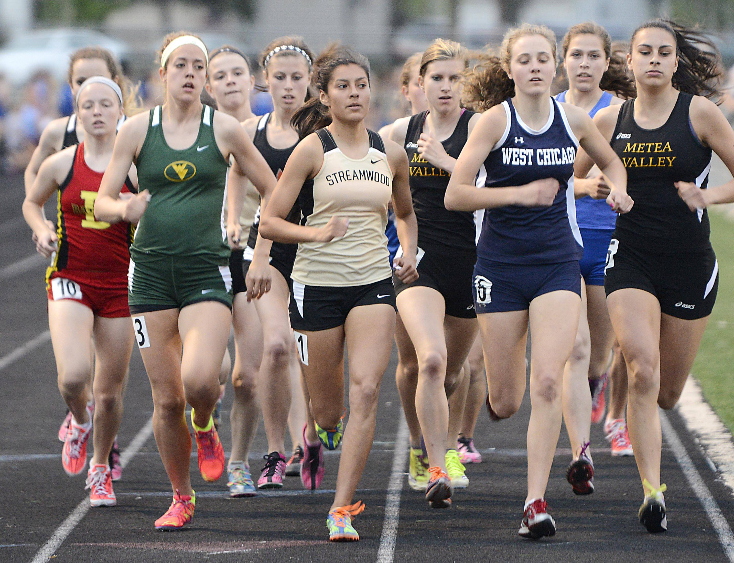 Streamwood's Gabby Juarez leads the pack at the one lap mark of the 1,600 meter run Thursday at the Upstate Eight Conference girls track meet at Geneva High School. She finished second.