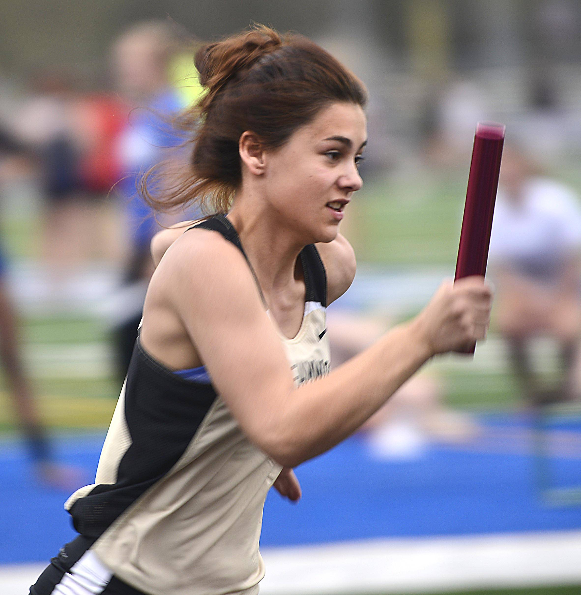 Streamwood's Sophia Roberts starts the 4x200 meter relay for the Sabres Thursday at the Upstate Eight Conference girls track meet at Geneva High School.